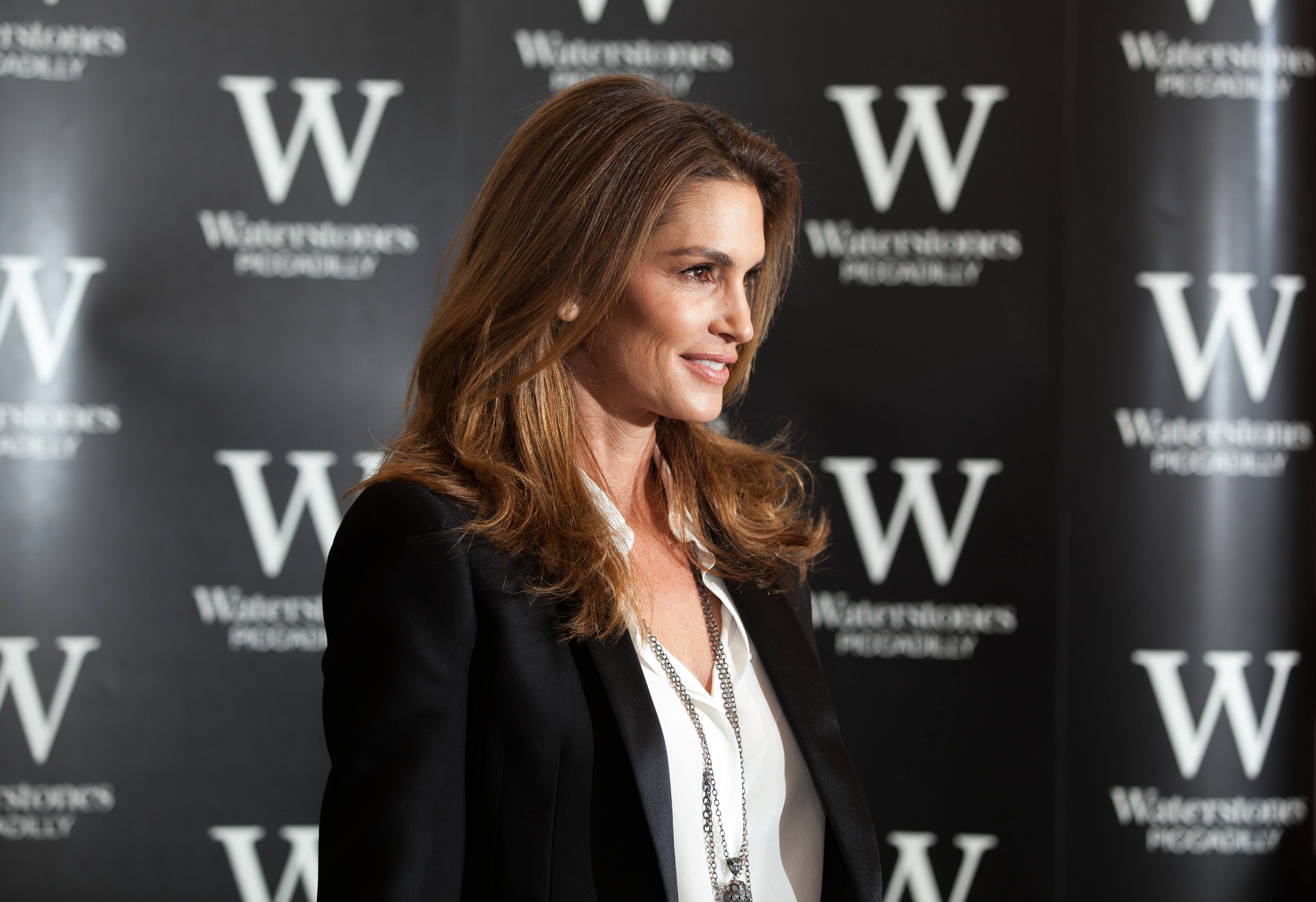Ex-supermodel Cindy Crawford  poses for photographers  at the launch of her book in central London, Oct. 2,  2015
