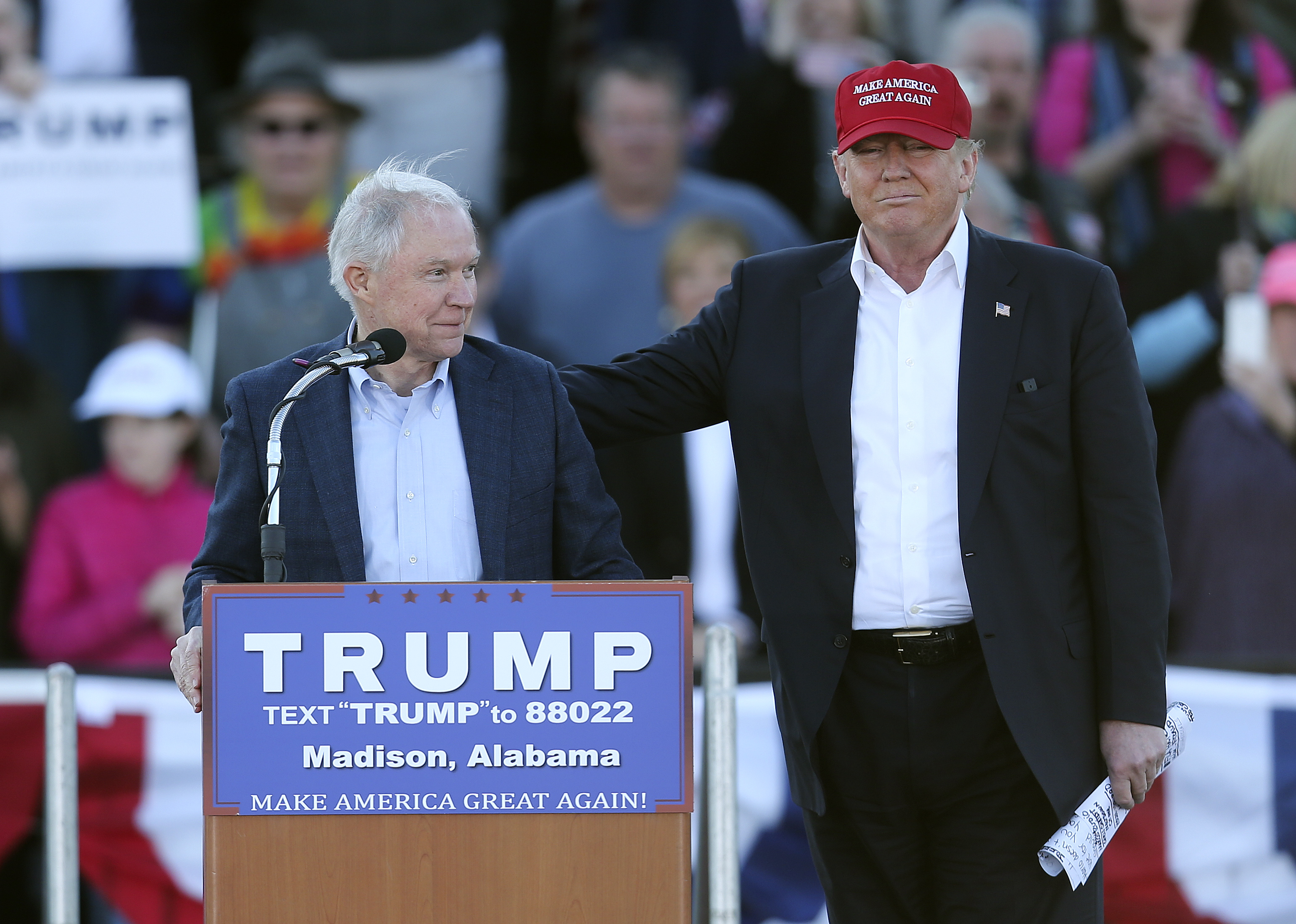Republican presidential candidate Donald Trump, right, stands next to Sen. Jeff Sessions, R-Ala., as Sessions speaks  during a rally Sunday, Feb. 28, 2016, in Madison, Ala.