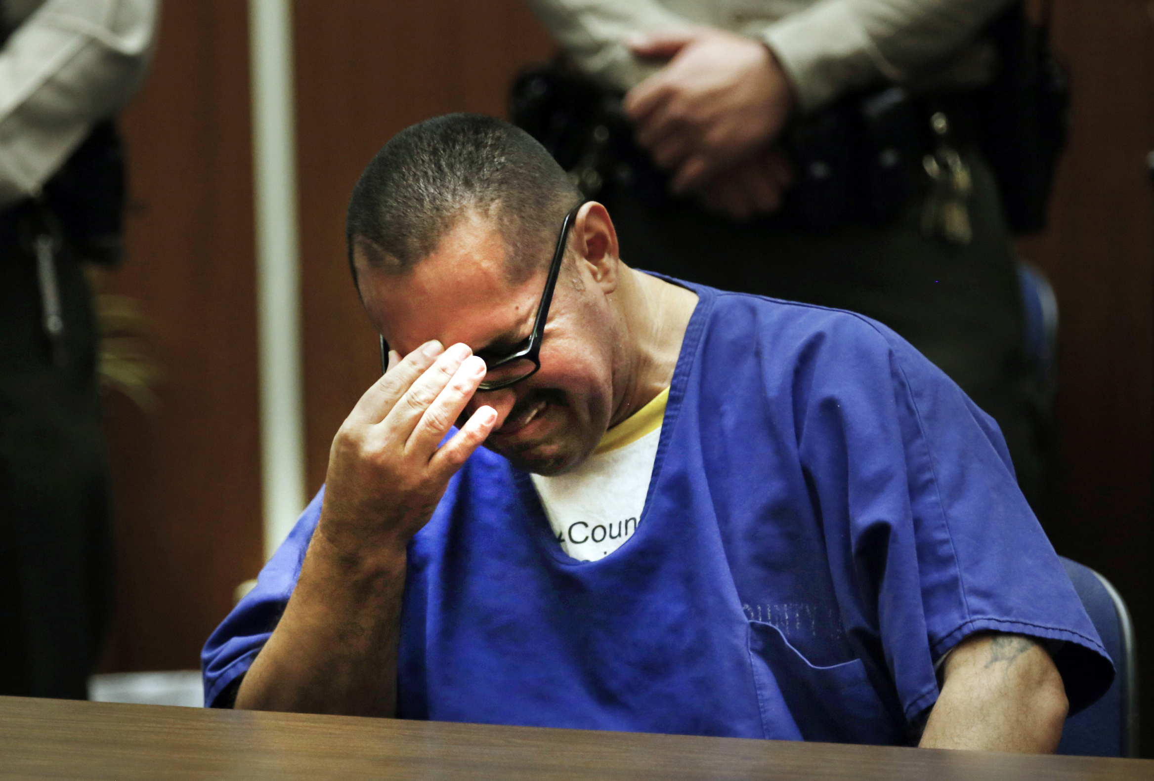 Luis Vargas, who had been in prison for 16 years, reacts in court as he is exonerated, Nov. 23, 2015, in Los Angeles