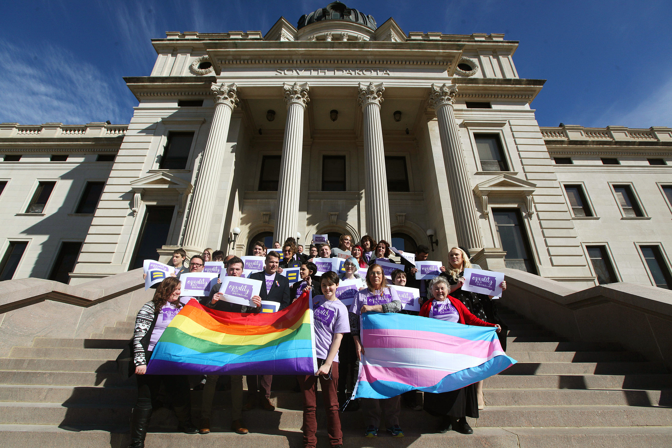Representatives from the Center for Equality, American Civil Liberties Union of South Dakota, LGBT supporters and members of the Human Rights Campaign stand on the front steps of the State Capitol, on Feb. 23, 2016.