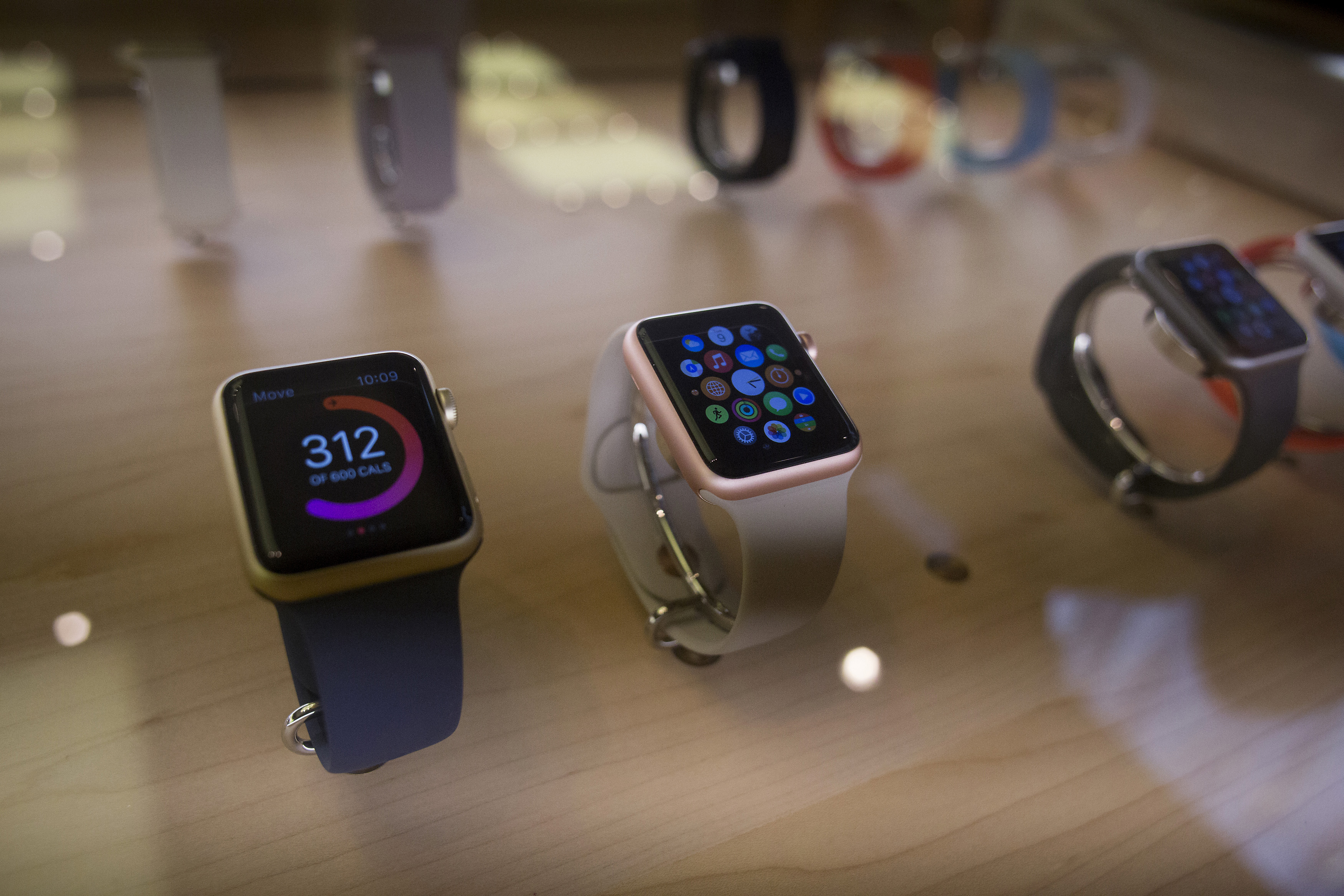 Apple Watch Sport devices in rose gold and gold finishes are displayed at an Apple Inc. store in New York, U.S., on Thursday, Sept. 10, 2015.