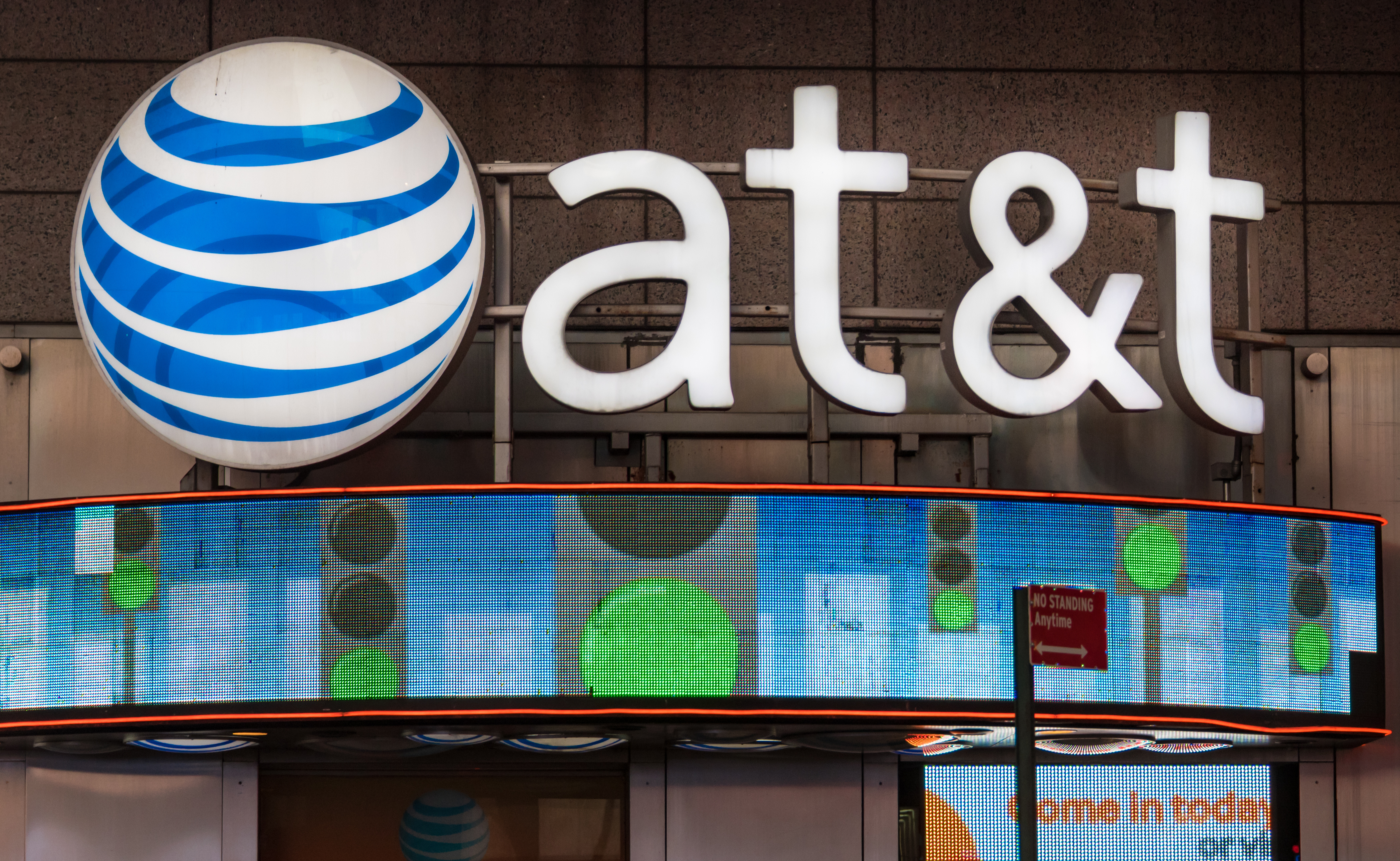 AT&T office New York City, USA: Signage and logo outside its office glowing at night.                                      AT&T Inc. is an American multinational telecommunications corporation, headquartered at Whitacre Tower in downtown Dallas, Texas. (Photo by Roberto Machado Noa/LightRocket via Getty Images)