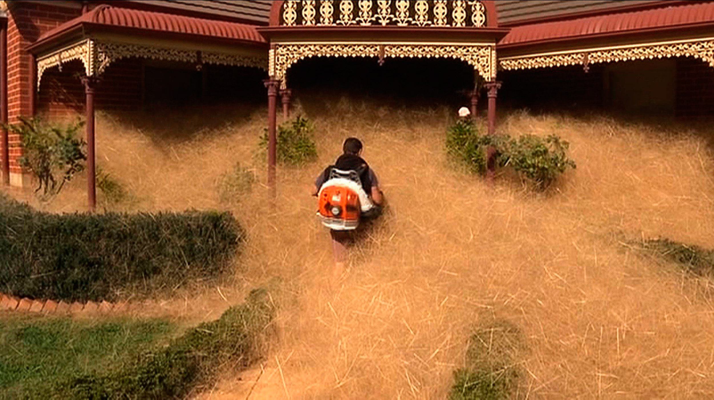 This frame grab from footage released by Australian television's Channel 7 on Feb. 18, 2016, shows a man clearing out fast-growing tumbleweed from a home in the town of Wangaratta, 150 miles northeast of Melbourne, Australia.