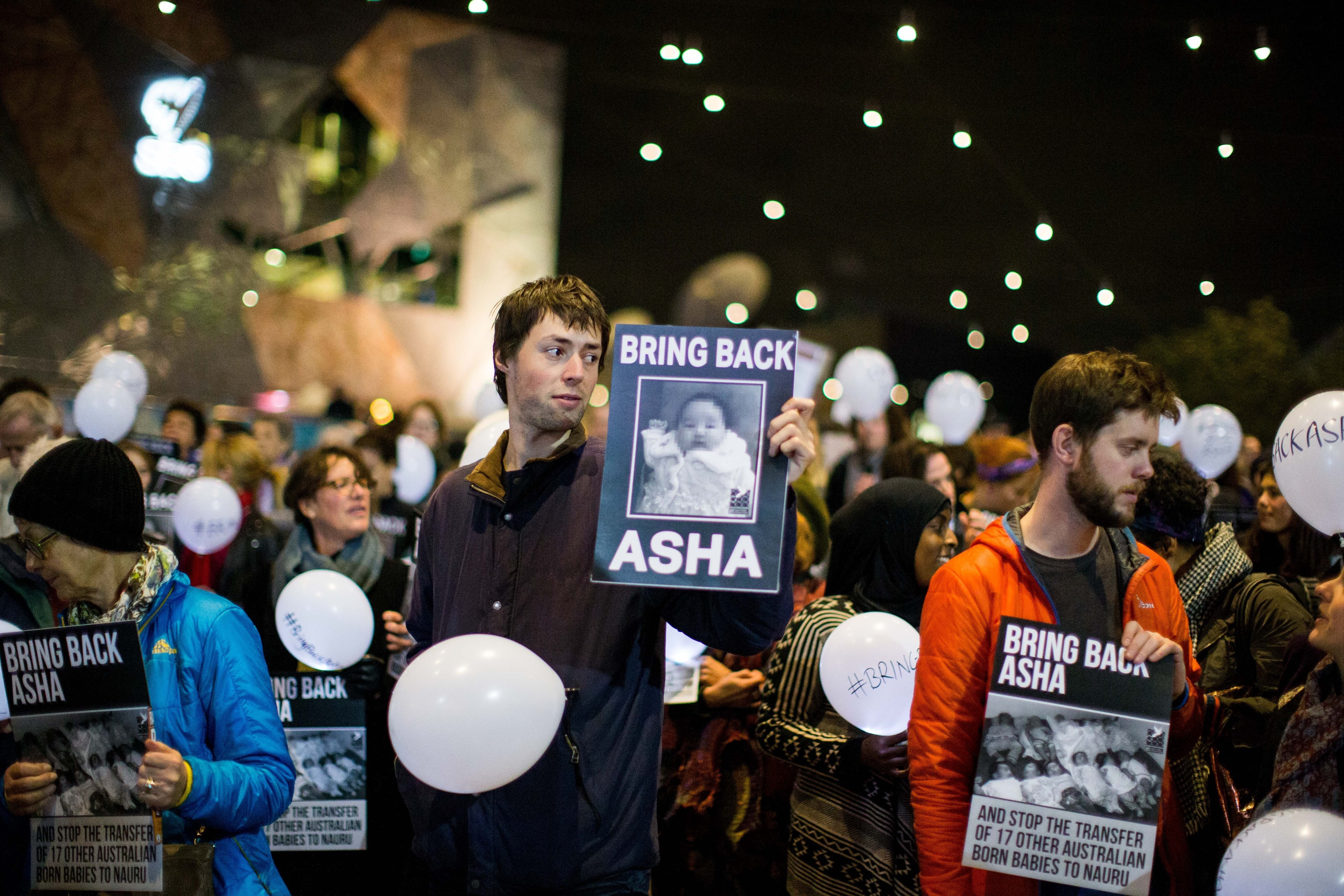 Protestors at a rally at Melbourne's Federation Square to protest the deportation of 5 month old refugee 'Asha' to Nauru, in Melbourne, Australia on June 25, 2015.