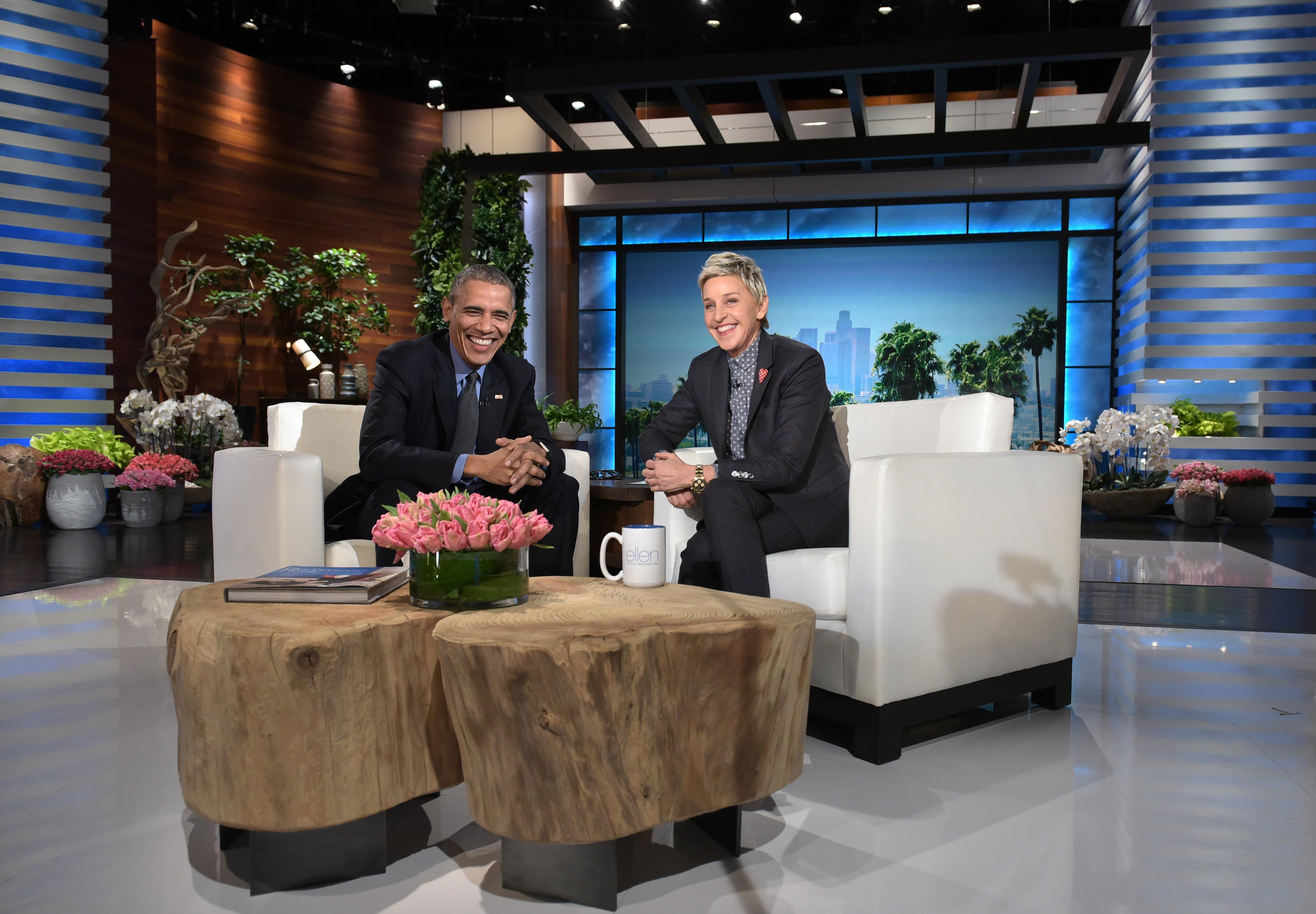 US President Barack Obama and talk show host Ellen DeGeneres are seen during a break in the taping of The Ellen DeGeneres show at Warner Brothers Studios in Burbank, Calif. on Feb. 11, 2016.