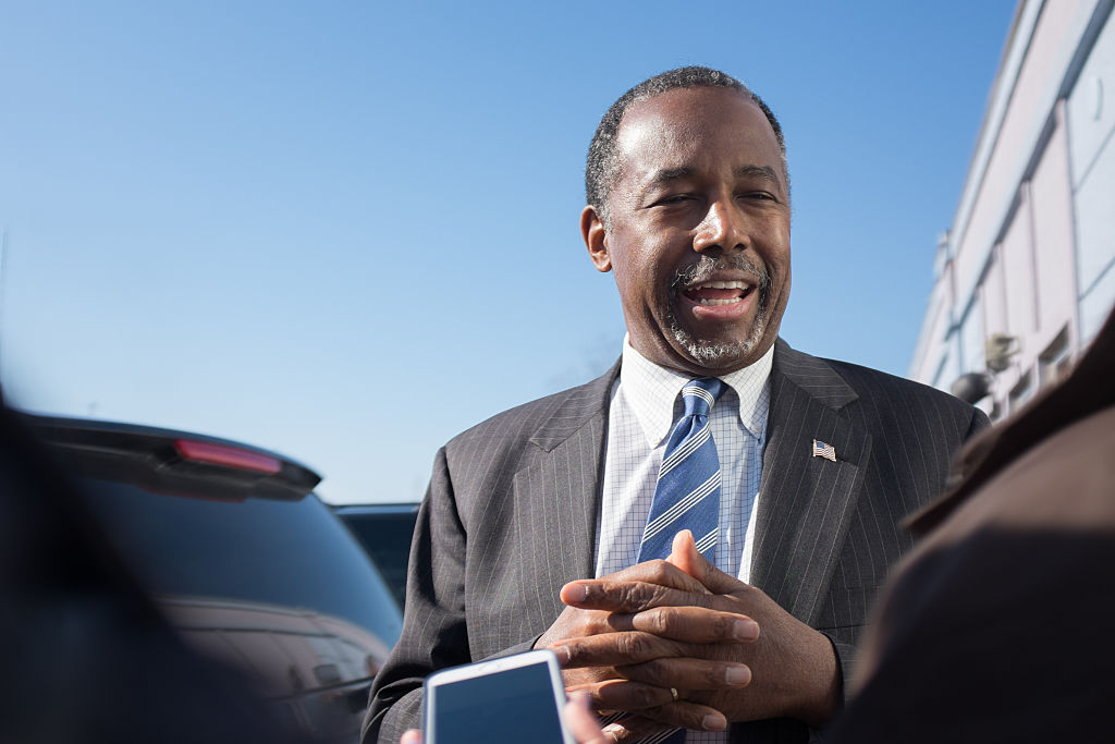 Republican presidential candidate Ben Carson speaks to reporters after stopping at The Airport Diner on Feb. 7, 2016 in Manchester, New Hampshire.