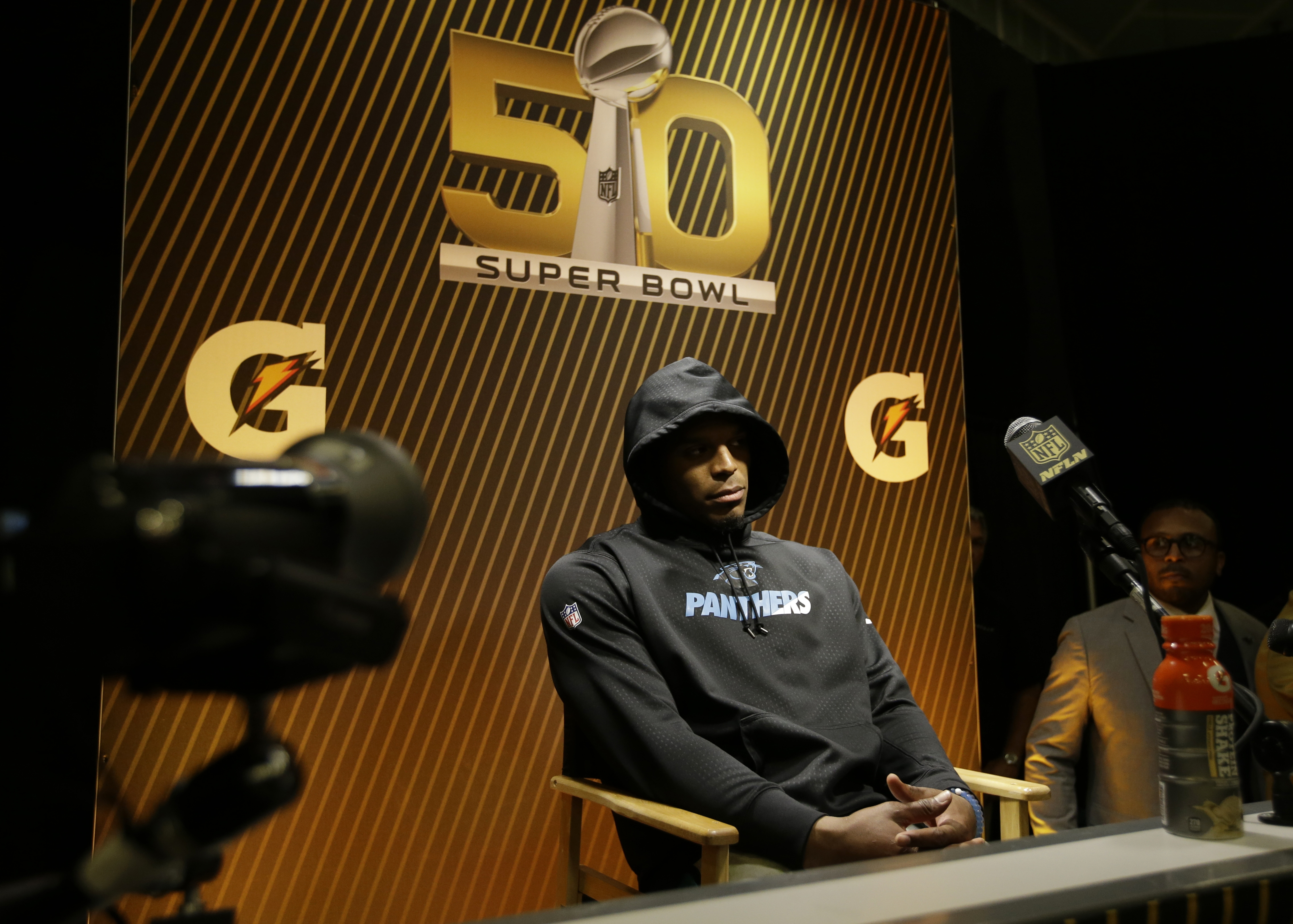 Carolina Panthers,' Cam Newton answers questions after the NFL Super Bowl 50 football game against the Denver Broncos in Santa Clara, Calif. on Feb. 7, 2016.