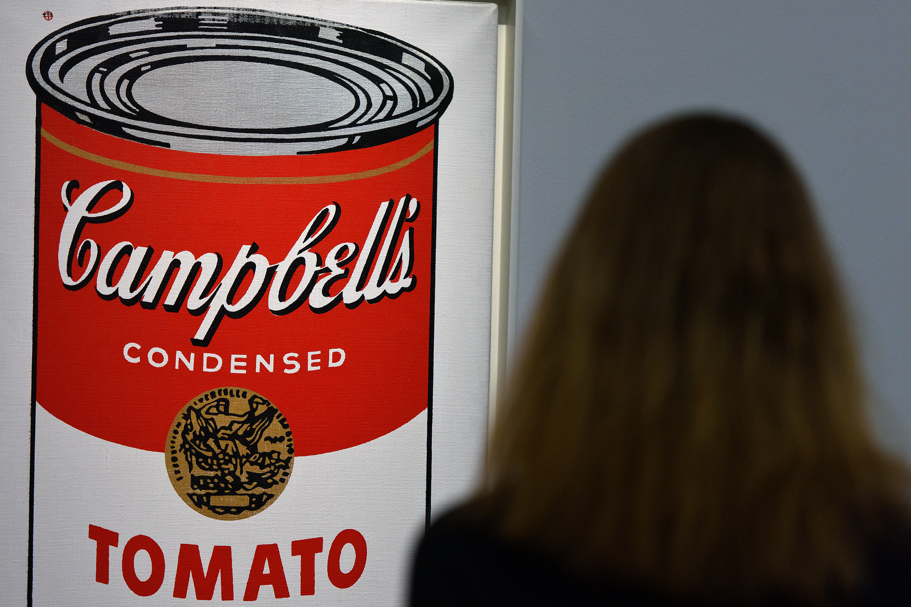 A guest views Large Campbell's Soup Can by Andy Warhol at Sotheby's Giants Of 20th Century Art Sale in London on Jan. 28, 2016.