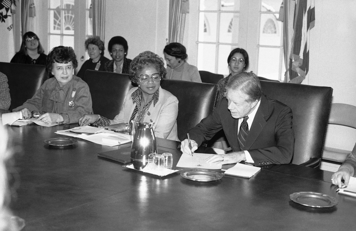 President Jimmy Carter signs document at the White House in Washington on Feb. 28, 1980, proclaiming March 2-8  National Women's History Week.
