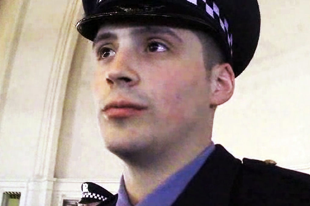 Officer Robert Rialmo states what becoming an officer means to him during a interview with a Chicago Tribune reporter at the Chicago Police Academy graduation ceremony on March 26, 2013.