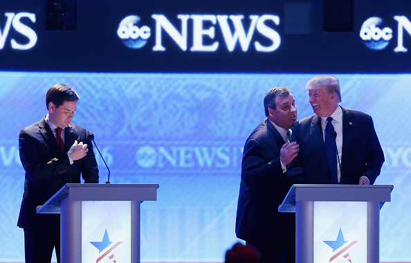 Republican presidential candidates New Jersey Governor Chris Christie (2nd R) and Donald Trump visit as Sen. Marco Rubio (R-FL) (L) stands close by during a commercial break in the Republican presidential debate at St. Anselm College February 6, 2016 in Manchester, New Hampshire.