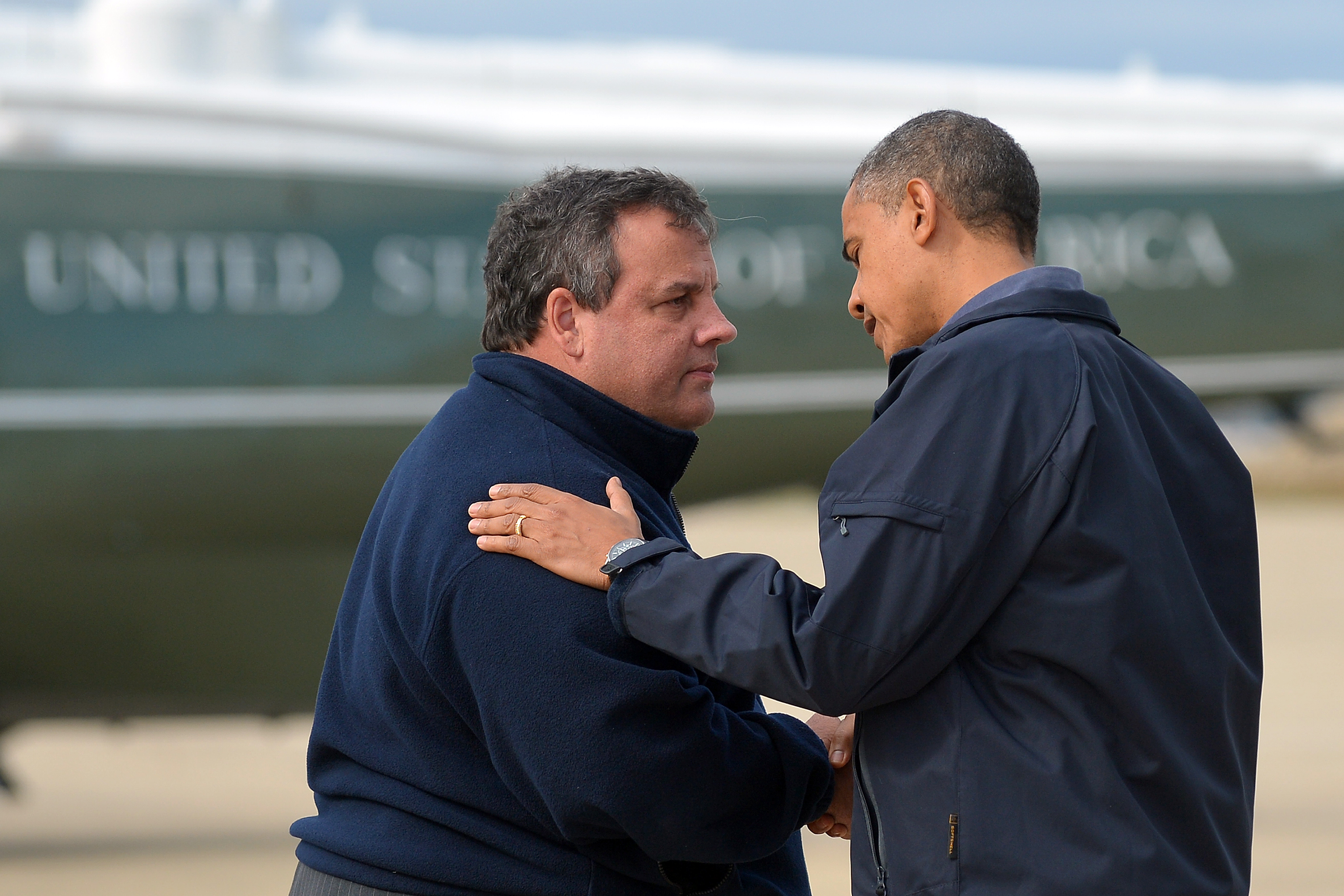 President Barack Obama is greeted by New Jersey Governor Chris Christie upon arriving in Atlantic City, New Jersey, on Oct. 31, 2012 to visit areas hardest hit by the unprecedented cyclone Sandy.