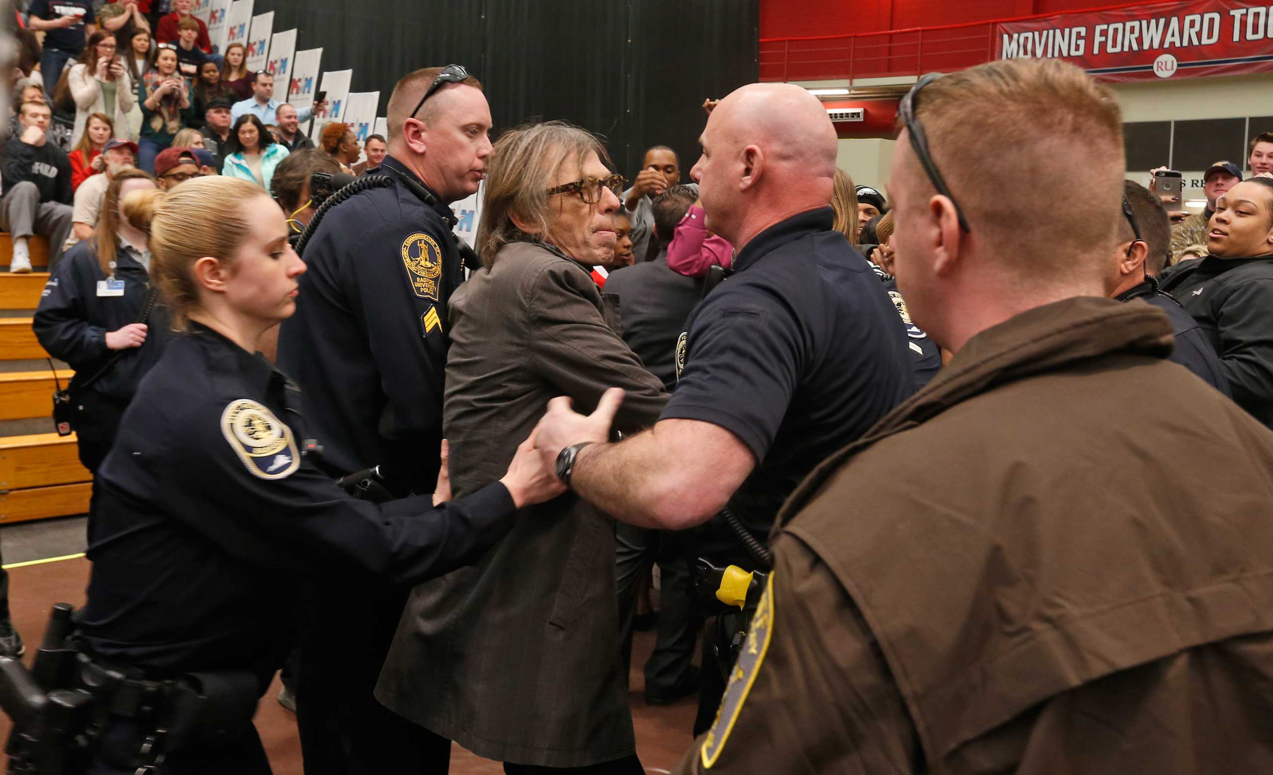 TIME photographer Christopher Morris is detained by police during a rally of Republican presidential candidate, Donald Trump, at Radford University in Radford, Va., Feb. 29, 2016.