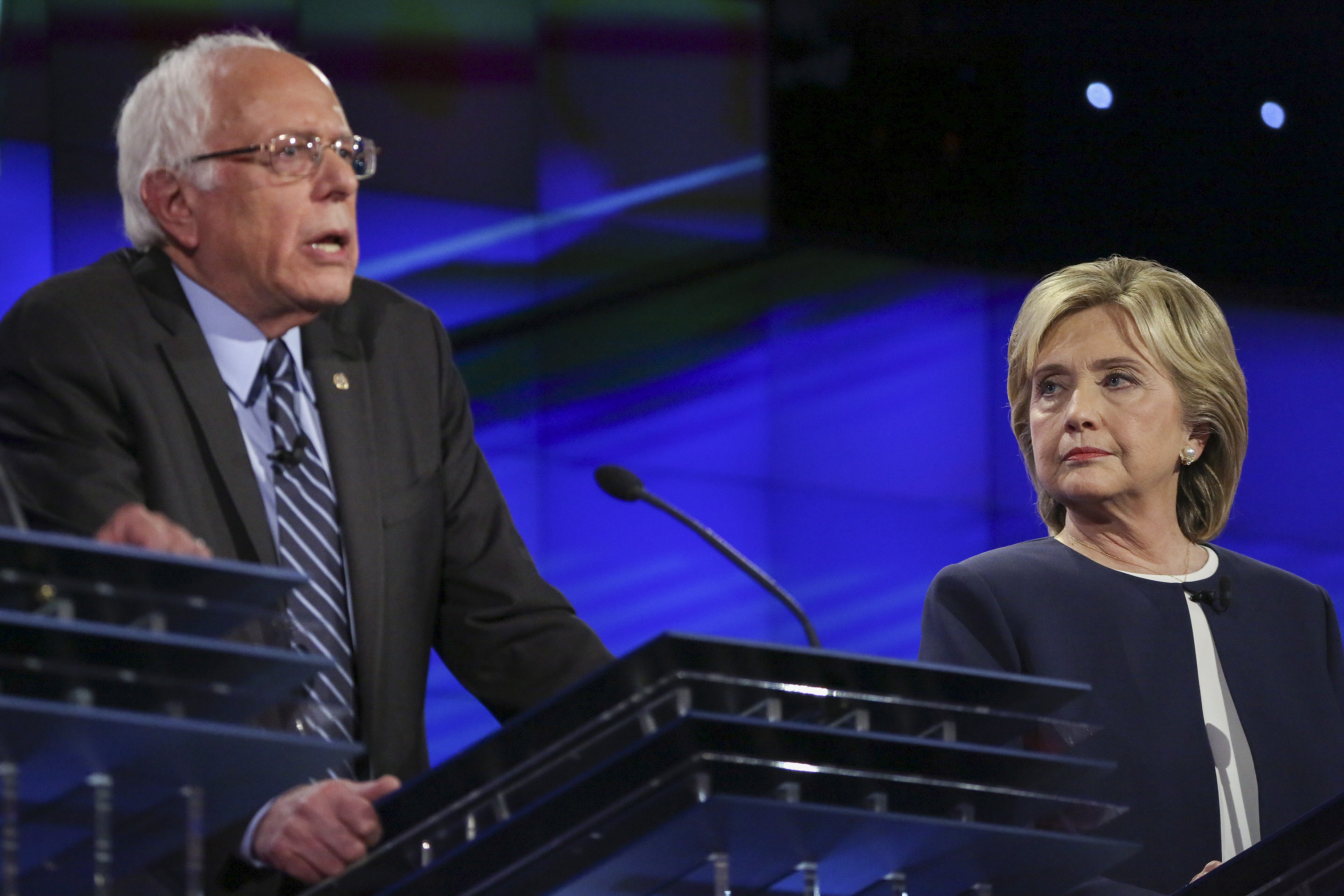 Hillary Clinton and Bernie Sanders participate in the first Democratic presidential debate in Las Vegas, on Oct. 13, 2015.