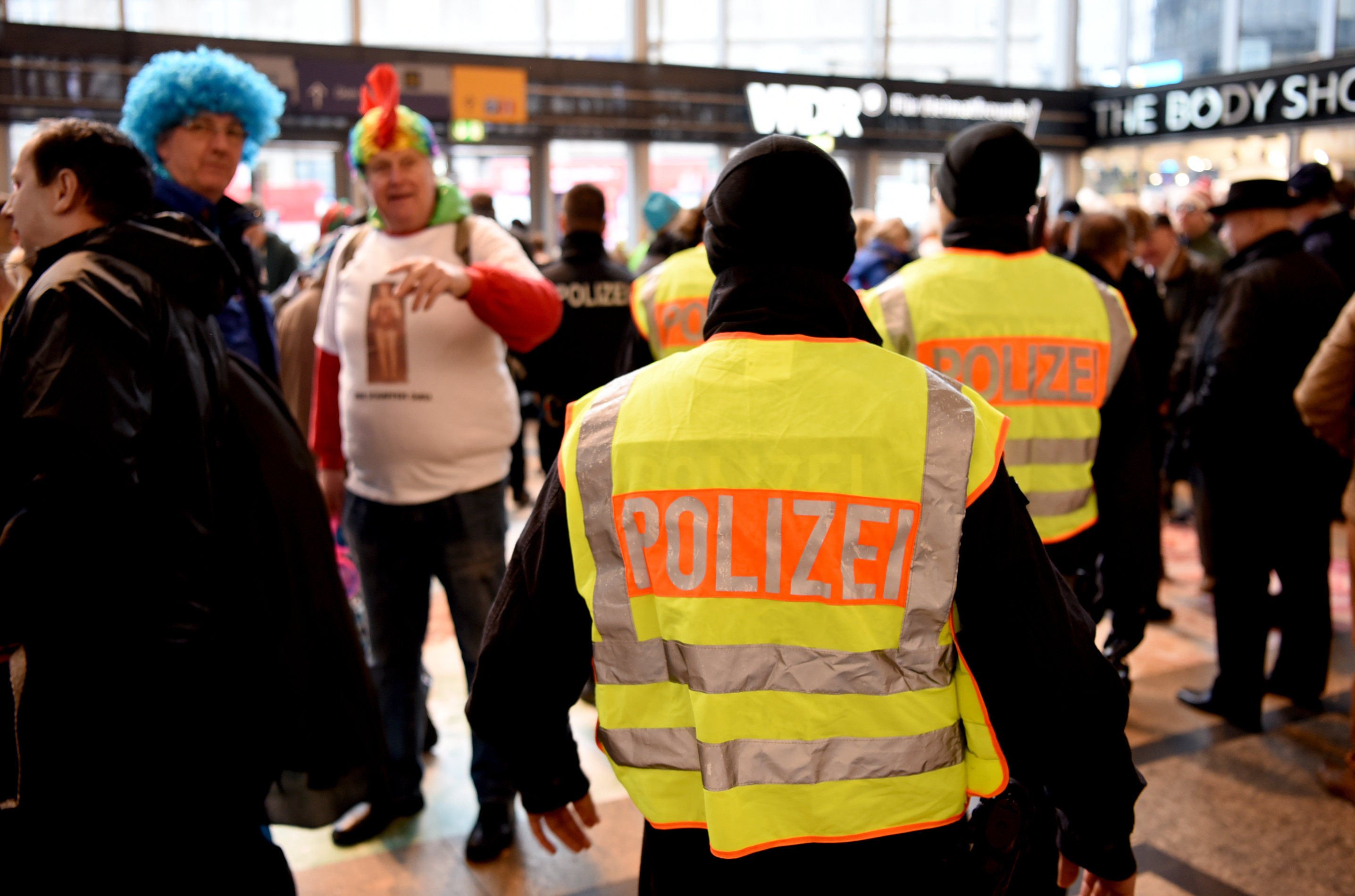 Police officers, part of beefed-up security to prevent sexual assaults, stand near the central station in Cologne on Feb. 4 as Carnival kicks off.