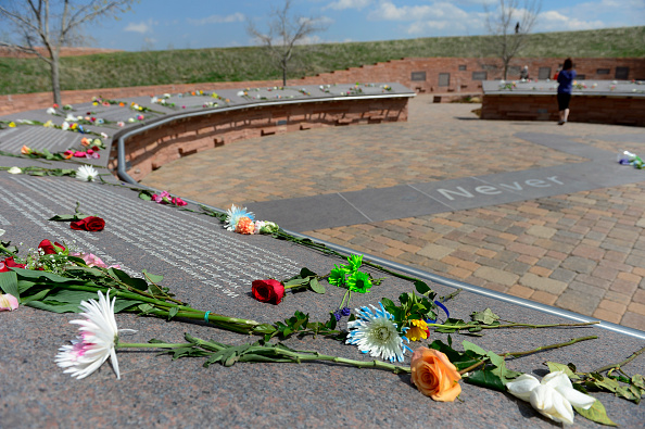 Visitors bring flowers and spend time at the Columbine Memorial on April 20, 2015.