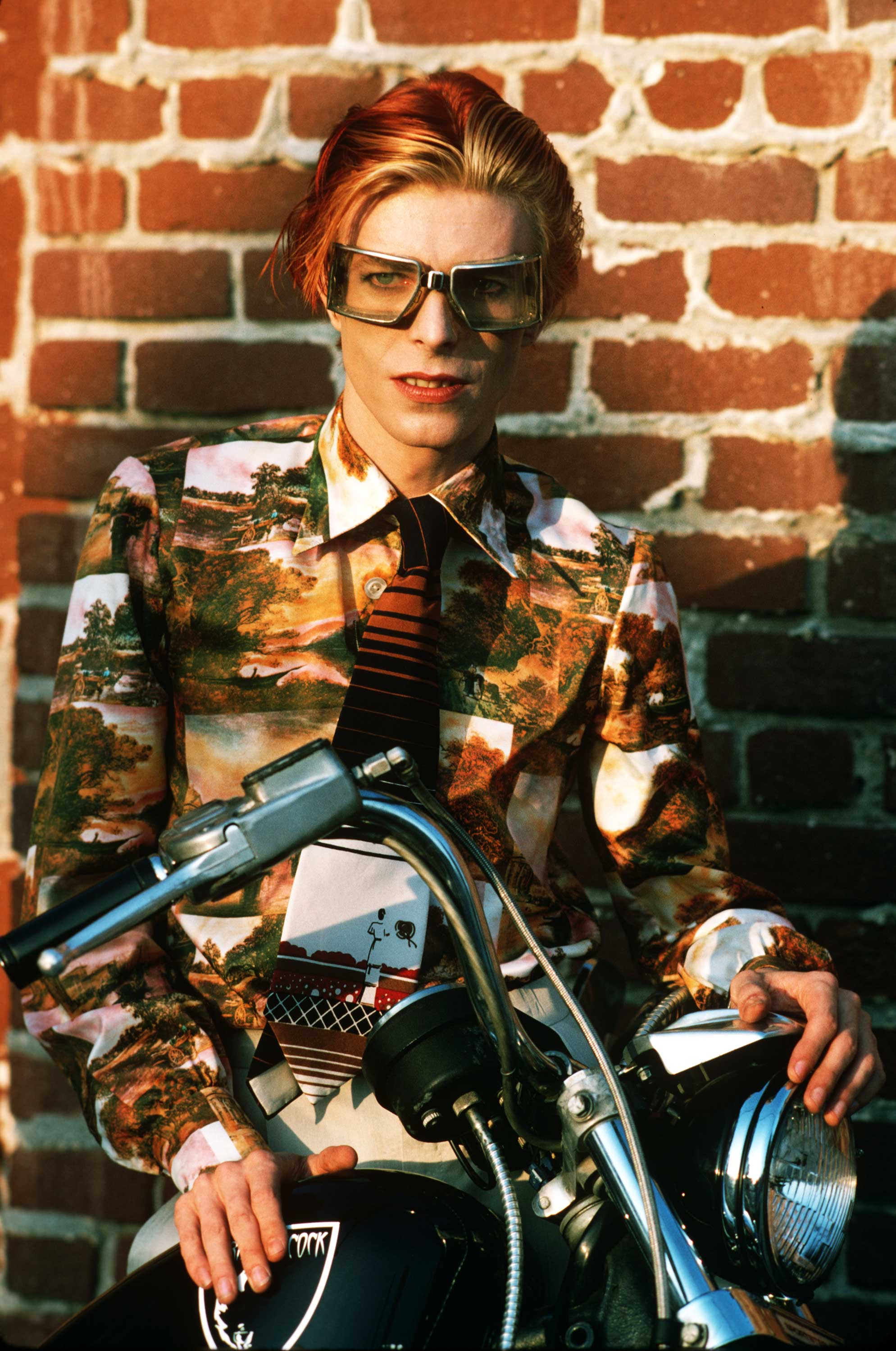 In this previously unpublished photo, David is seen with goggles and bike. Los Angeles, 1974.