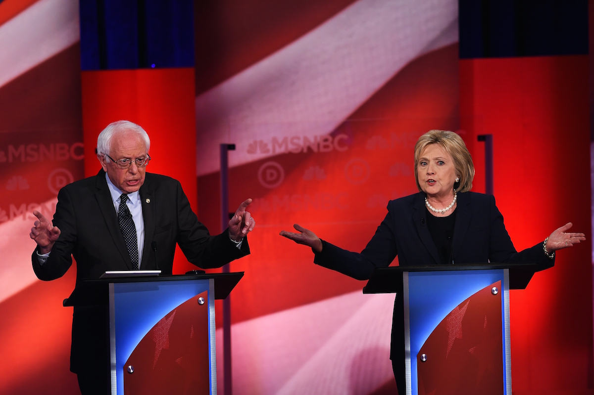 US Democratic presidential candidates Hillary Clinton (R) and Bernie Sanders participate in the MSNBC Democratic Candidates Debate at the University of New Hampshire in Durham on Feb. 4, 2016.