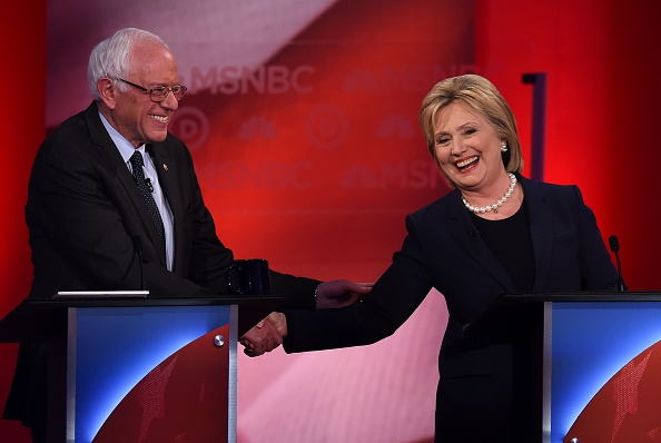 US Democratic presidential candidates Hillary Clinton (R) and Bernie Sanders shake hands as they participate in the MSNBC Democratic Candidates Debate at the University of New Hampshire in Durham on Feb. 4, 2016.