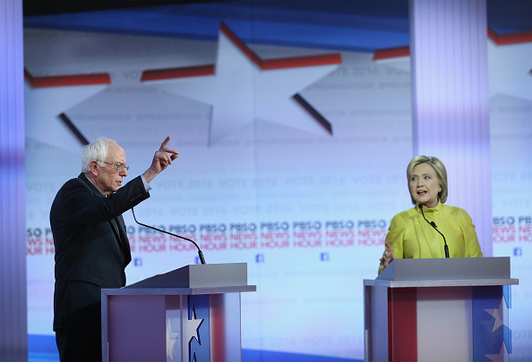 Democratic presidential candidates Senator Bernie Sanders (L) and Hillary Clinton participate in the PBS NewsHour Democratic presidential candidate debate at the University of Wisconsin-Milwaukee in Milwaukee on Feb. 11, 2016.