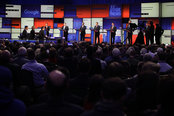 Republican presidential candidates (R-L) Ohio Governor John Kasich, Jeb Bush, Sen. Marco Rubio (R-FL), Sen. Ted Cruz (R-TX), Ben Carson, New Jersey Governor Chris Christie and Sen. Rand Paul (R-KY) wait for the beginning of the Fox News - Google GOP Debate January 28, 2016 at the Iowa Events Center in Des Moines, Iowa.