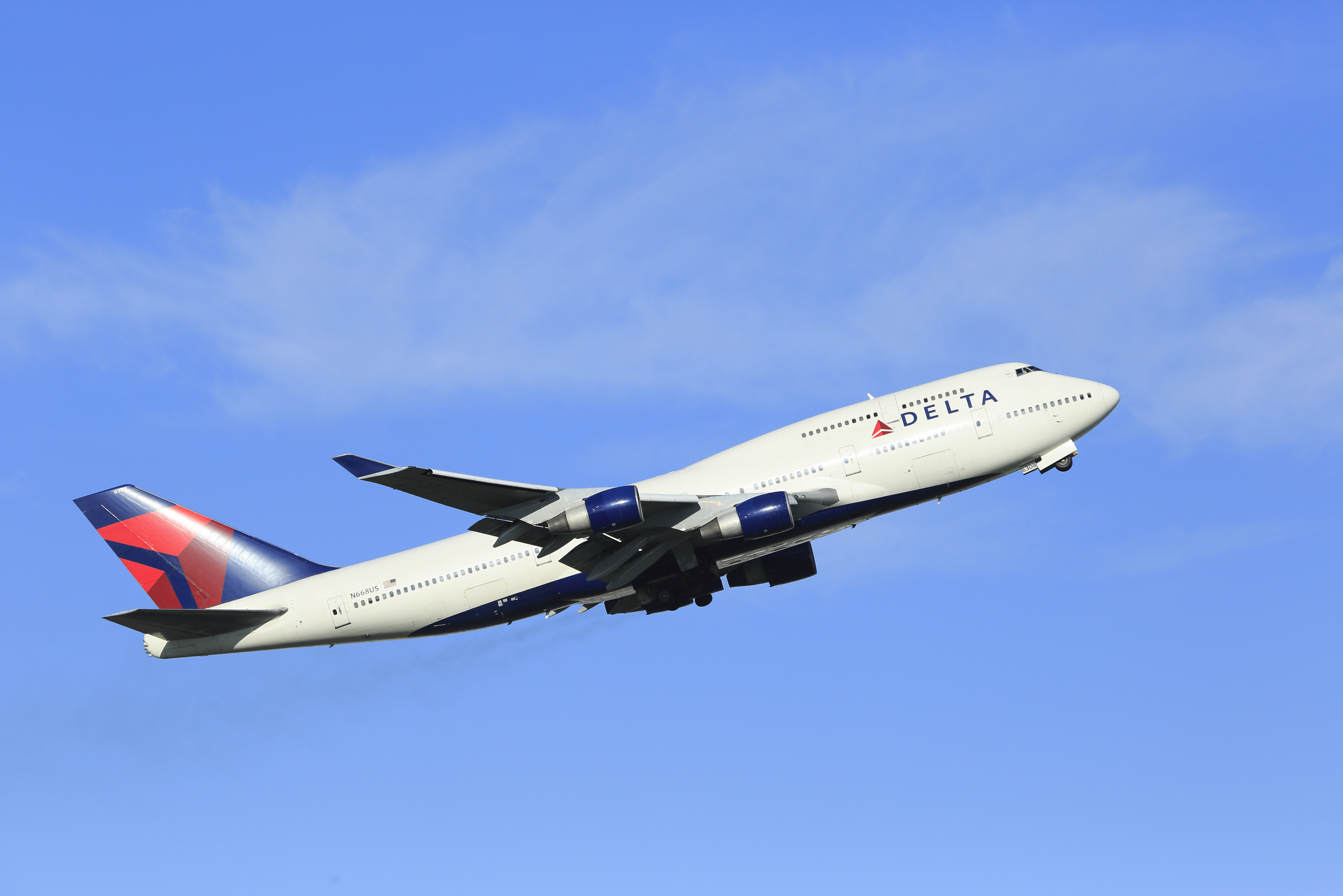 A Delta Airlines plane shown flying in the air.