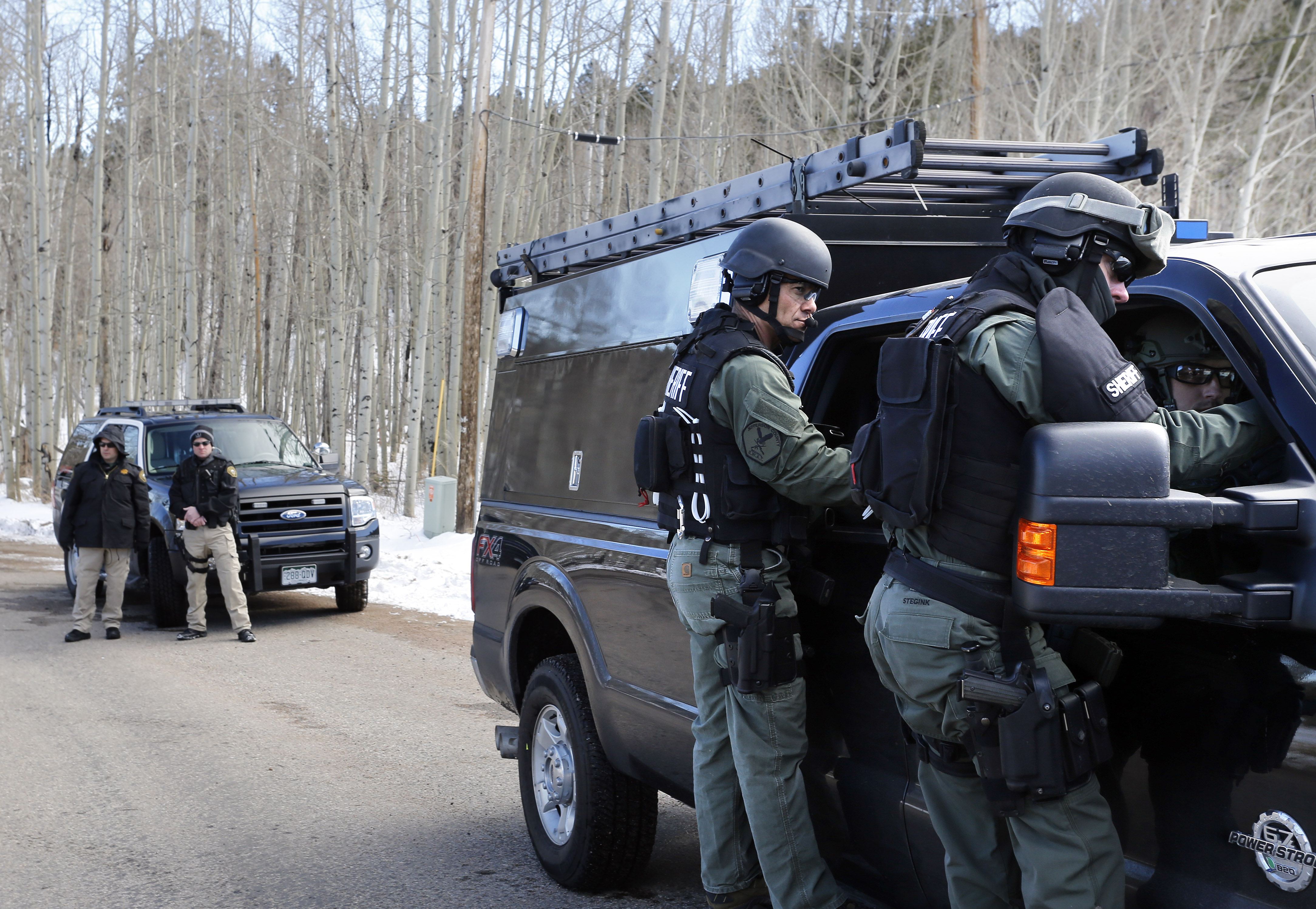 Jefferson County SWAT officers work at the scene where a man opened fire on sheriff's deputies before the officers returned fire, killing the man, outside Bailey, Colo. on Feb. 24, 2016.