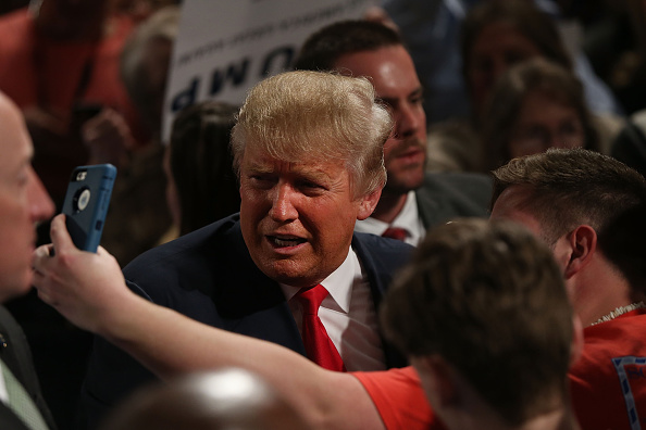 Republican presidential candidate Donald Trump poses for a picture after speaking on February 17, 2016 in Sumter, South Carolina.