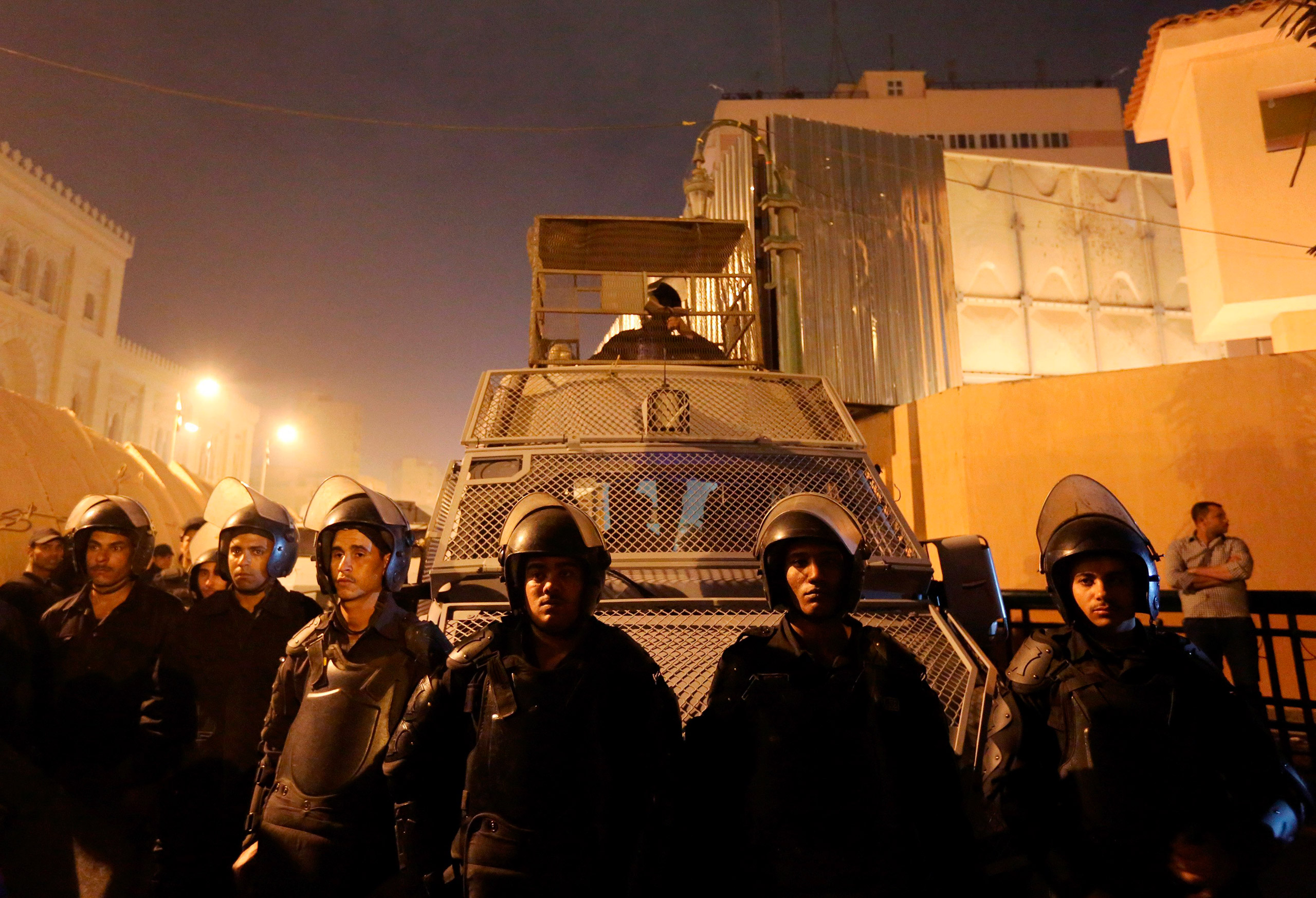 Riot police stand guard as protesters gather in front of the Cairo security directorate after a policeman fatally shot a man in the street, Cairo, Egypt, Feb. 18, 2016.