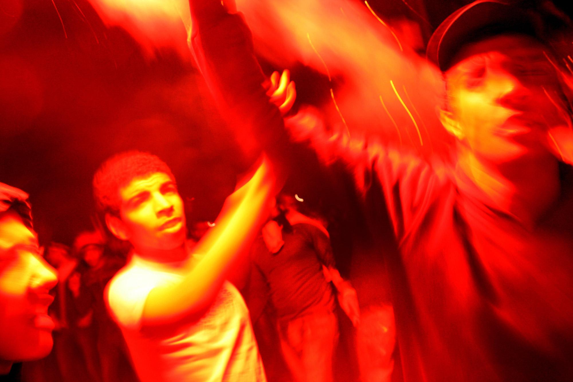 6:46 p.m. Demonstrators light fireworks and dance while celebrating the resignation of Egyptian President Hosni Mubarak in Tahrir Square, Cairo, Feb. 11, 2011.