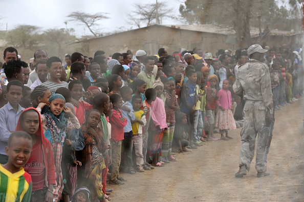 Local residents await the arrival of the UN secretary-general in Ogolcho in Ethiopia's drought affected Oromia region to tour various UN drought relief projects on Jan. 31, 2016.