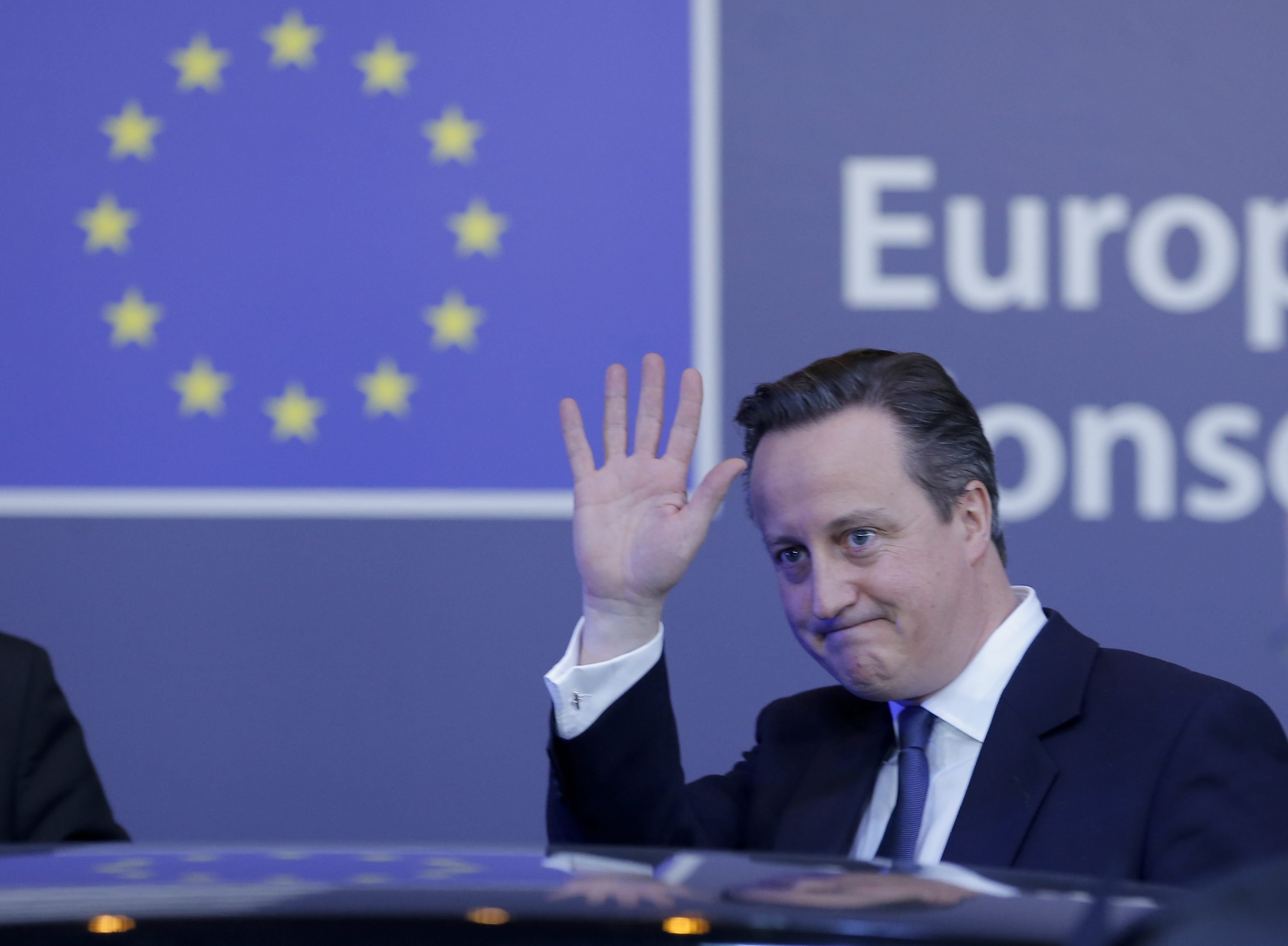 British Prime Minister David Cameron leaves at the end of a two day EU summit at EU headquarters in Brussels, Feb. 19, 2016.