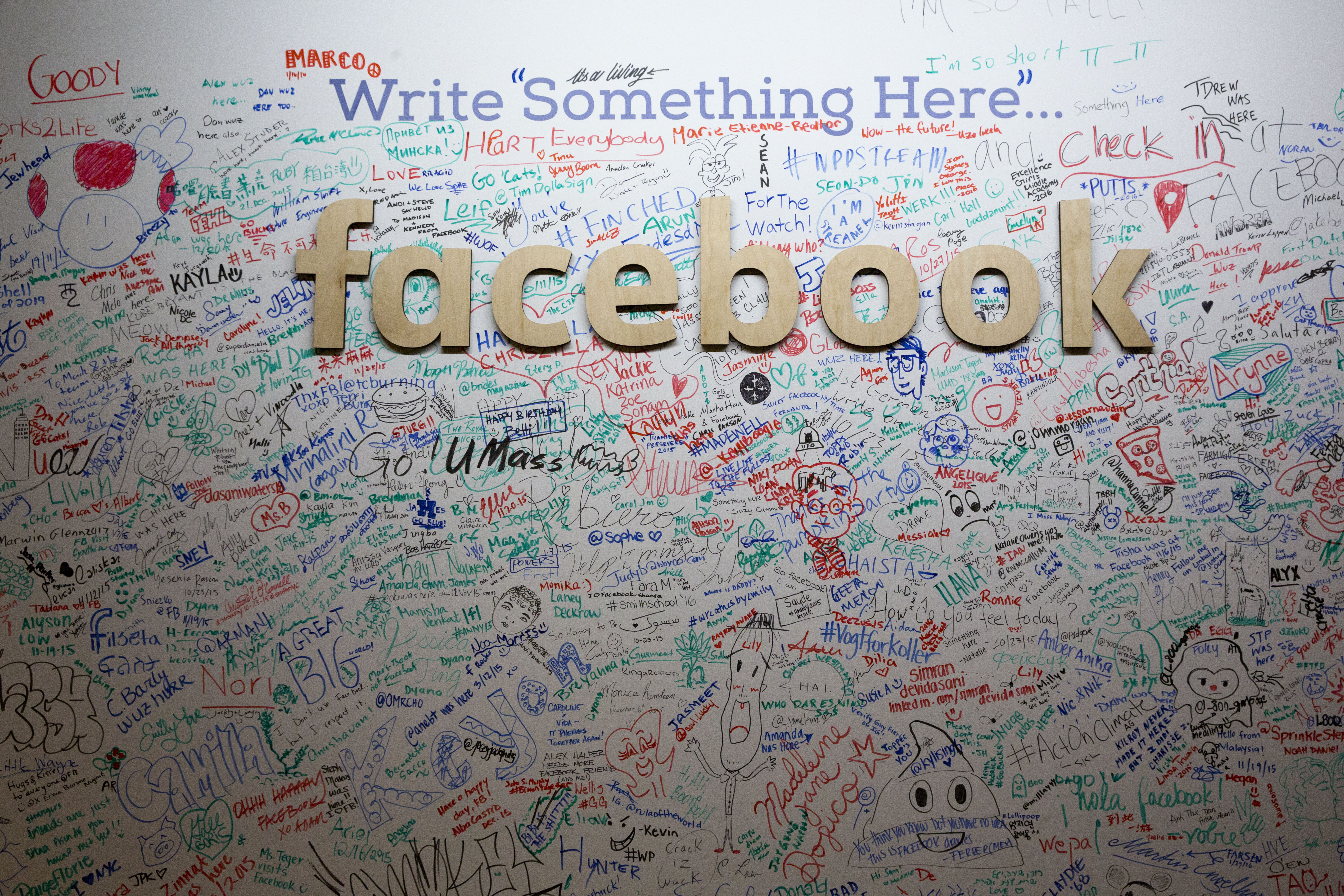 A signature wall at Facebook's New York office, photographed Feb. 18.