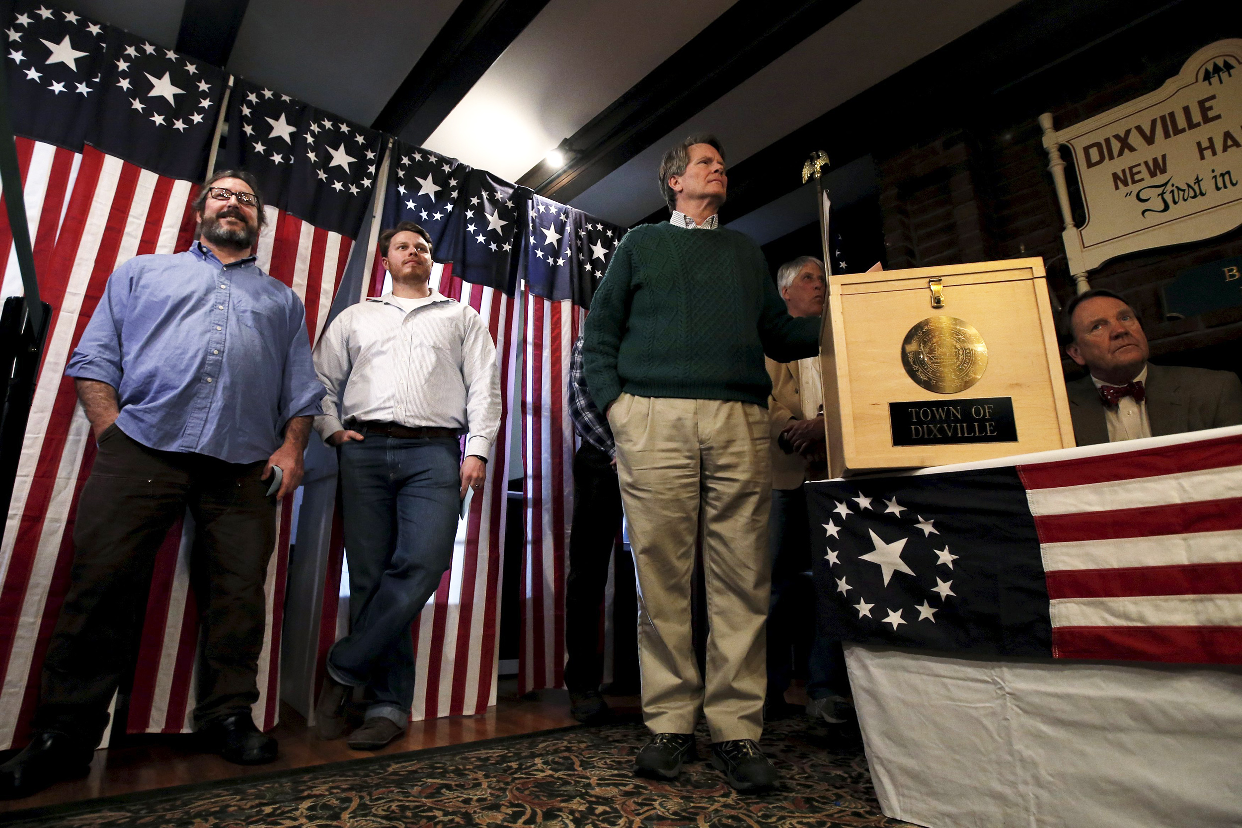 Jeff Stevens and other voters wait for the last few seconds to midnight to cast their votes in the U.S. Presidential primary election at the Hale House at Balsams Hotel in Dixville Notch, NH on Feb. 8, 2016.