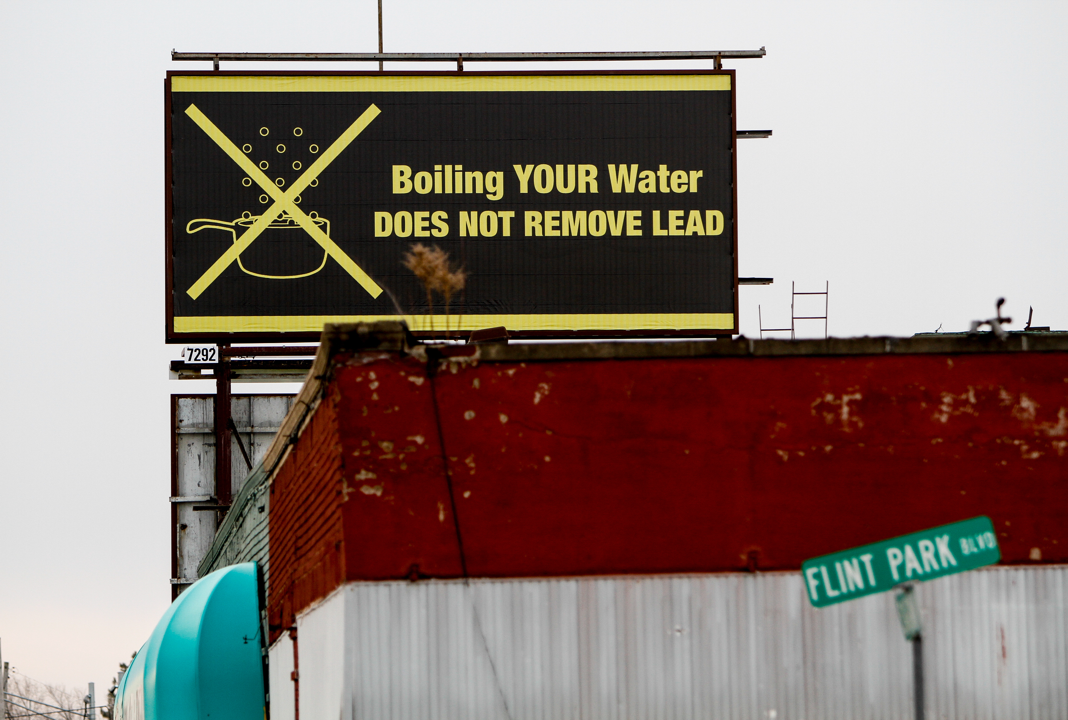 A sign tells Flint residents that boiling water doesn't remove lead on February 7, 2016 in Flint, Michigan. Months ago the city told citizens they could use tap water if they boiled it first, but now say it must be filtered to remove lead.