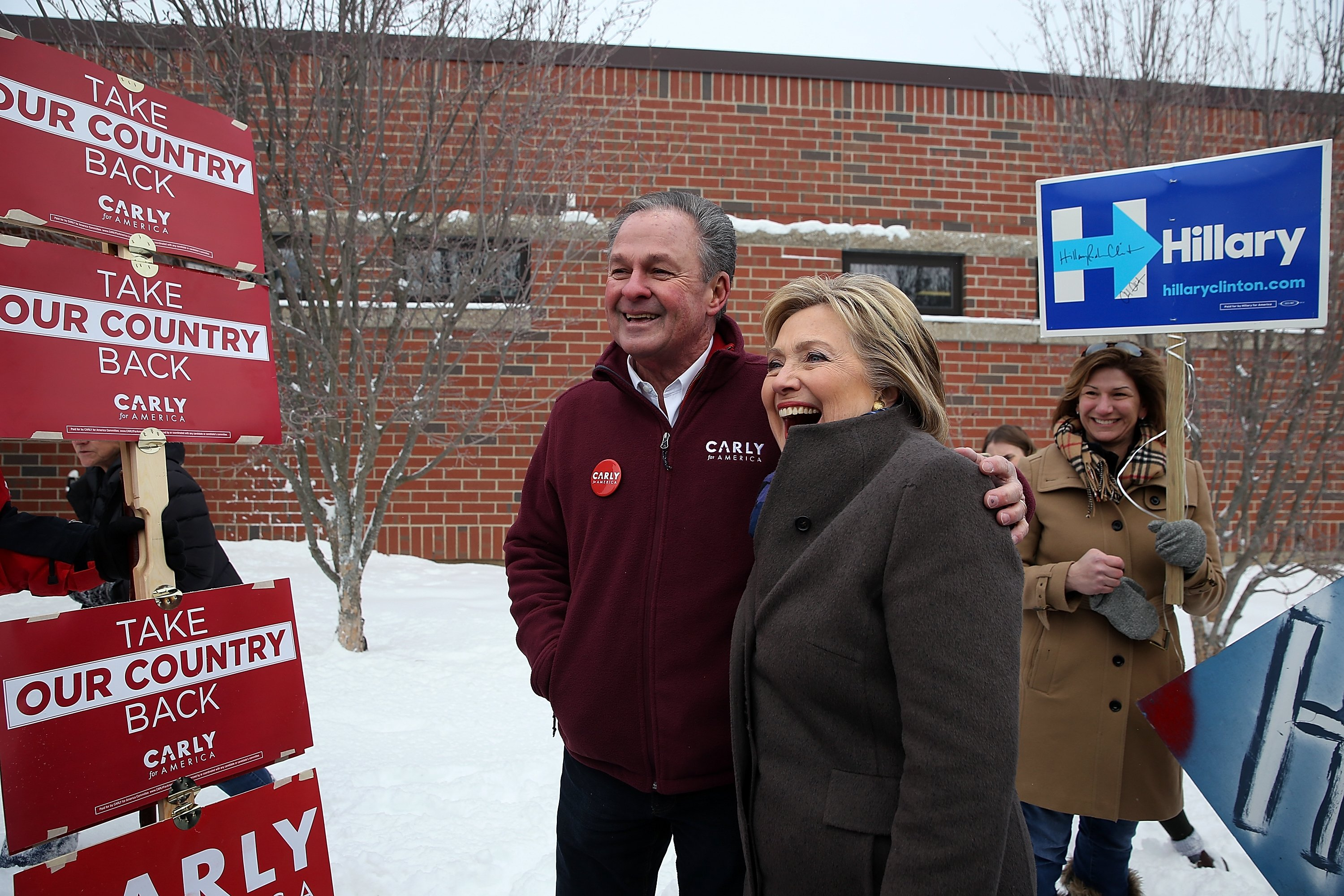 Hillary Clinton poses for a picture with Frank Fiorina in Derry, NH on Feb. 9, 2016.