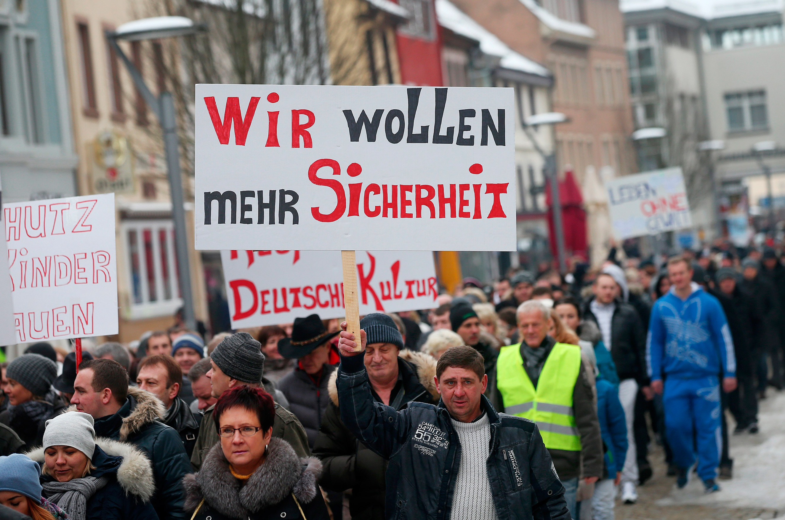 Hundreds of Russlanddeutsche, or ethnic Germans who had formerly lived in Russia, demonstrate with signs reading  we want more security  and against violence in Villingen-Schwenningen, Germany, Jan. 24, 2016. The demonstration took place in connection with the alleged rape of a 13-year-old girl by a refugee, which the police say did not happen.
