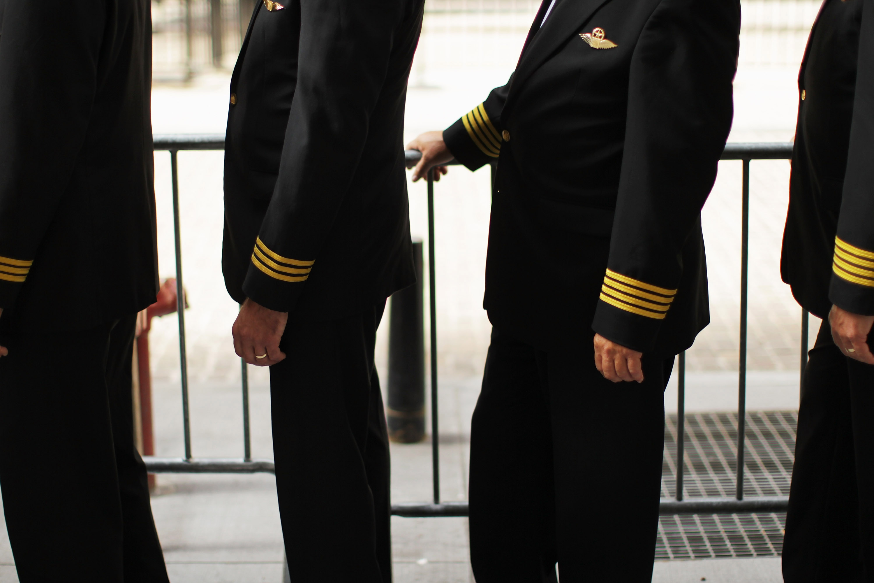 Over 700 hundred Continental and United pilots, joined by additional pilots from other Air Line Pilots Association (ALPA) carriers, demonstrate in front of Wall Street on September 27, 2011 in New York City.