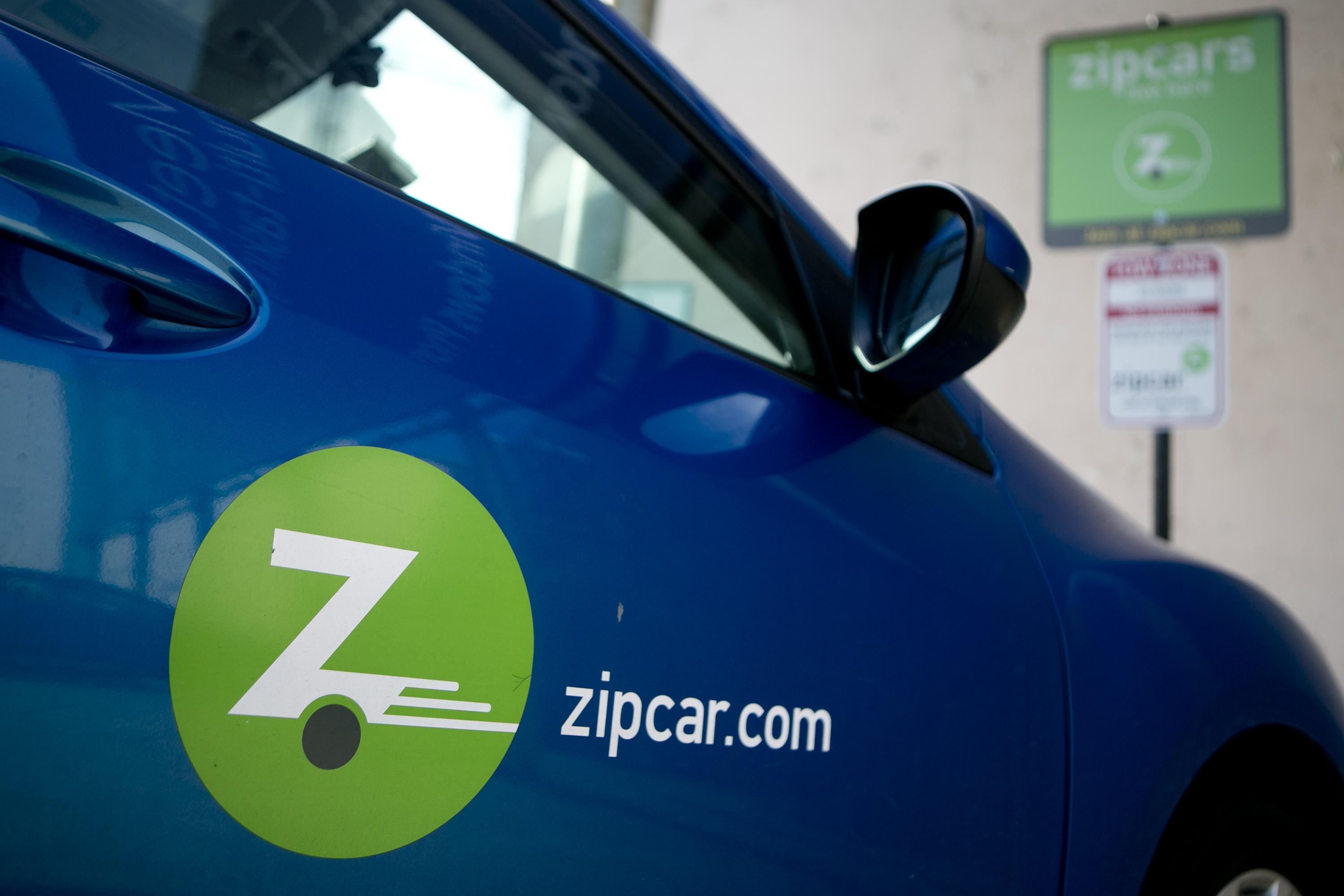 A Mazda Motor Corp. Zipcar Inc. vehicle sits parked in one of the company's spaces in Washington, D.C., U.S., on Wednesday, Jan. 2, 2013.