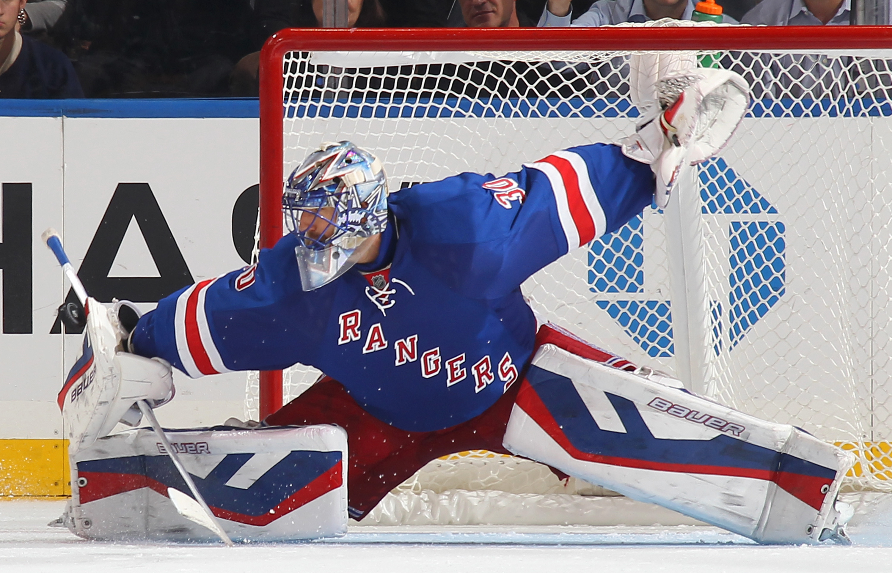 Henrik Lundqvist #30 of the New York Rangers makes a blocker save during the shootout against the Carolina Hurricanes at Madison Square Garden on October 16, 2014 in New York City.