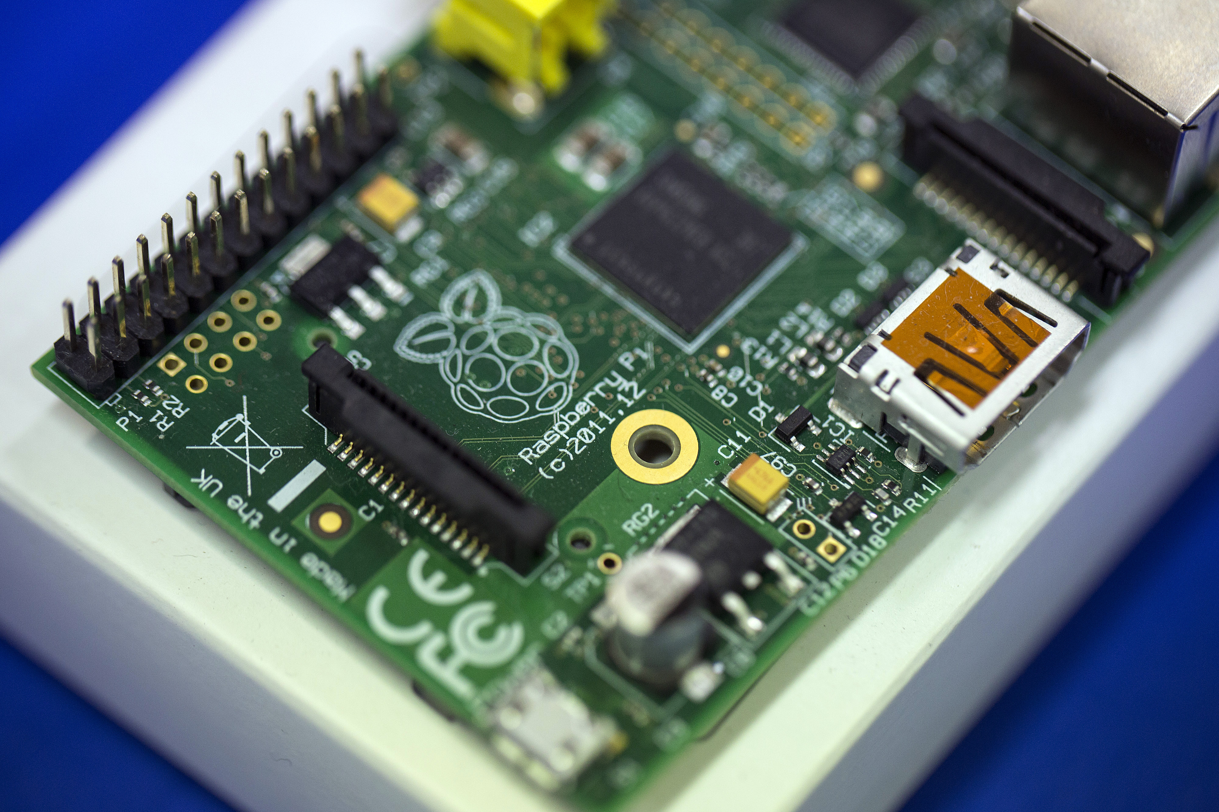 A logo sits on the printed circuit board (PCB) of a Raspberry Pi single-board computer following assembly at Sony Corp.'s technology centre in Pencoed, U.K., on Monday Dec. 16, 2013.