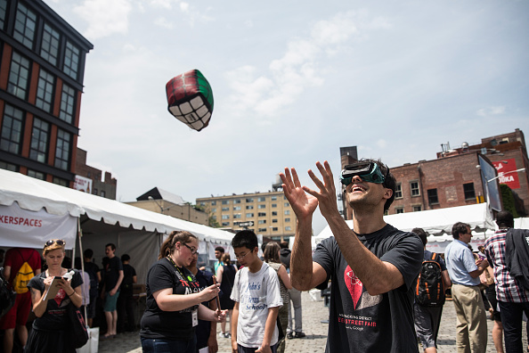 NEW YORK, NY - MAY 28: Michael Zaytsev attempts to catch a toy while wearing goggles that invert vision at Geek Street Fair on May 28, 2015 in the Meat Packing District neighborhood of New York City. The annual event, which is hosted by Google, encourages learning more about science, engineering and computer technology for people of all ages. (Photo by Andrew Burton/Getty Images)