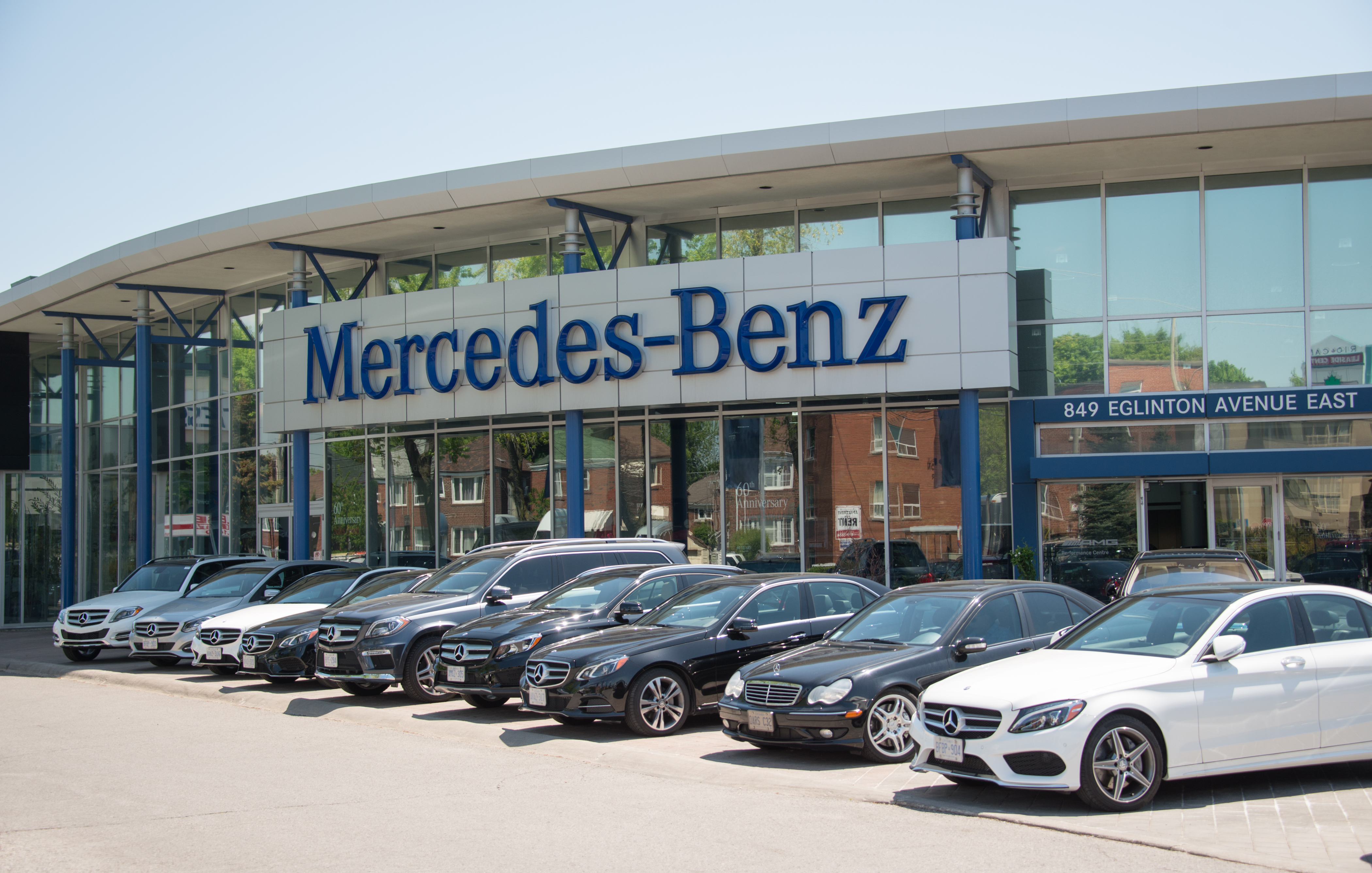 Mercedes Benz dealer in a city, outdoor display of the German luxury car.