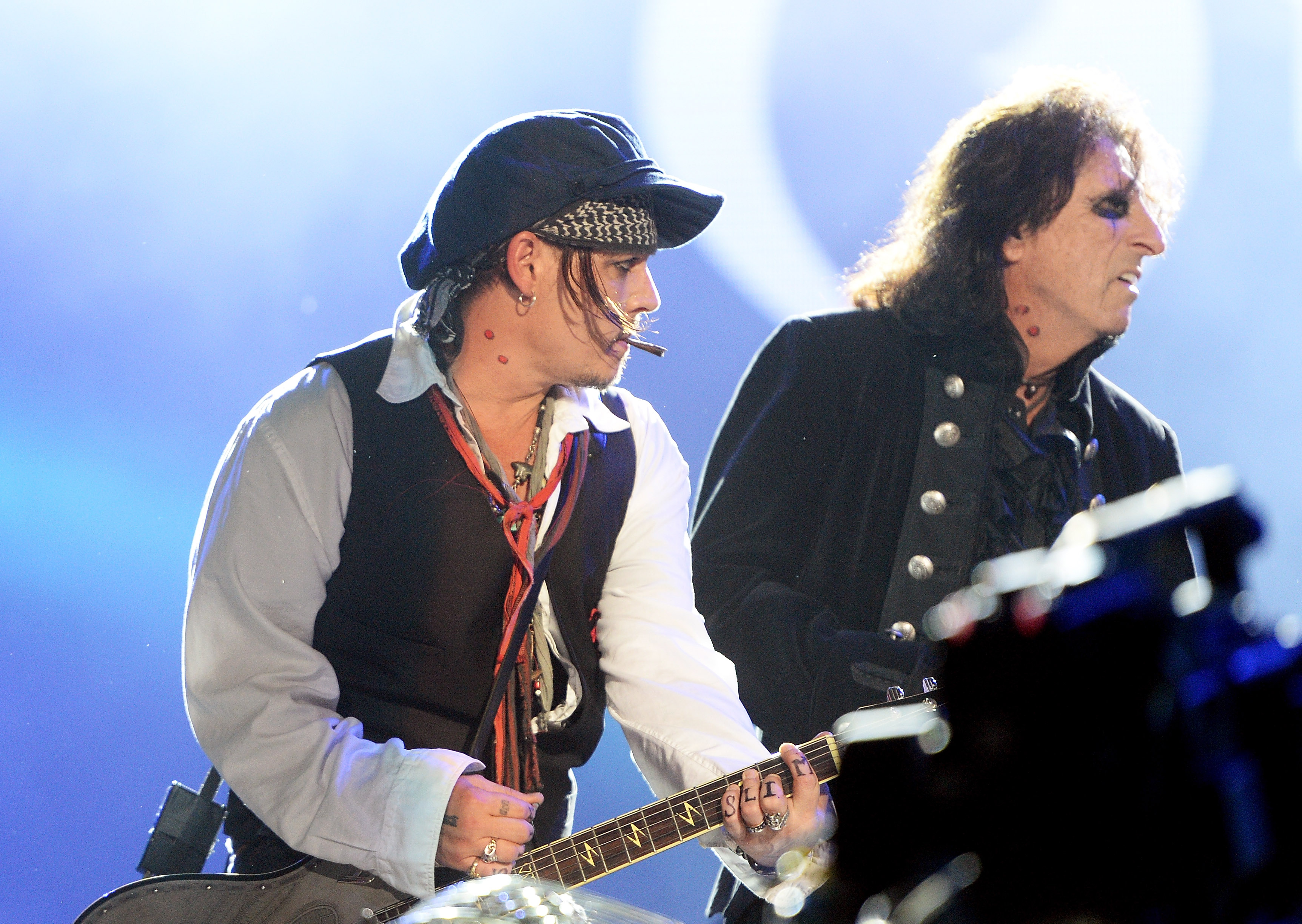 Alice Cooper (R) and Johnny Depp perform with The Hollywood Vampires during Rock in Rio on Sep. 24, 2015, in Rio de Janeiro, Brazil