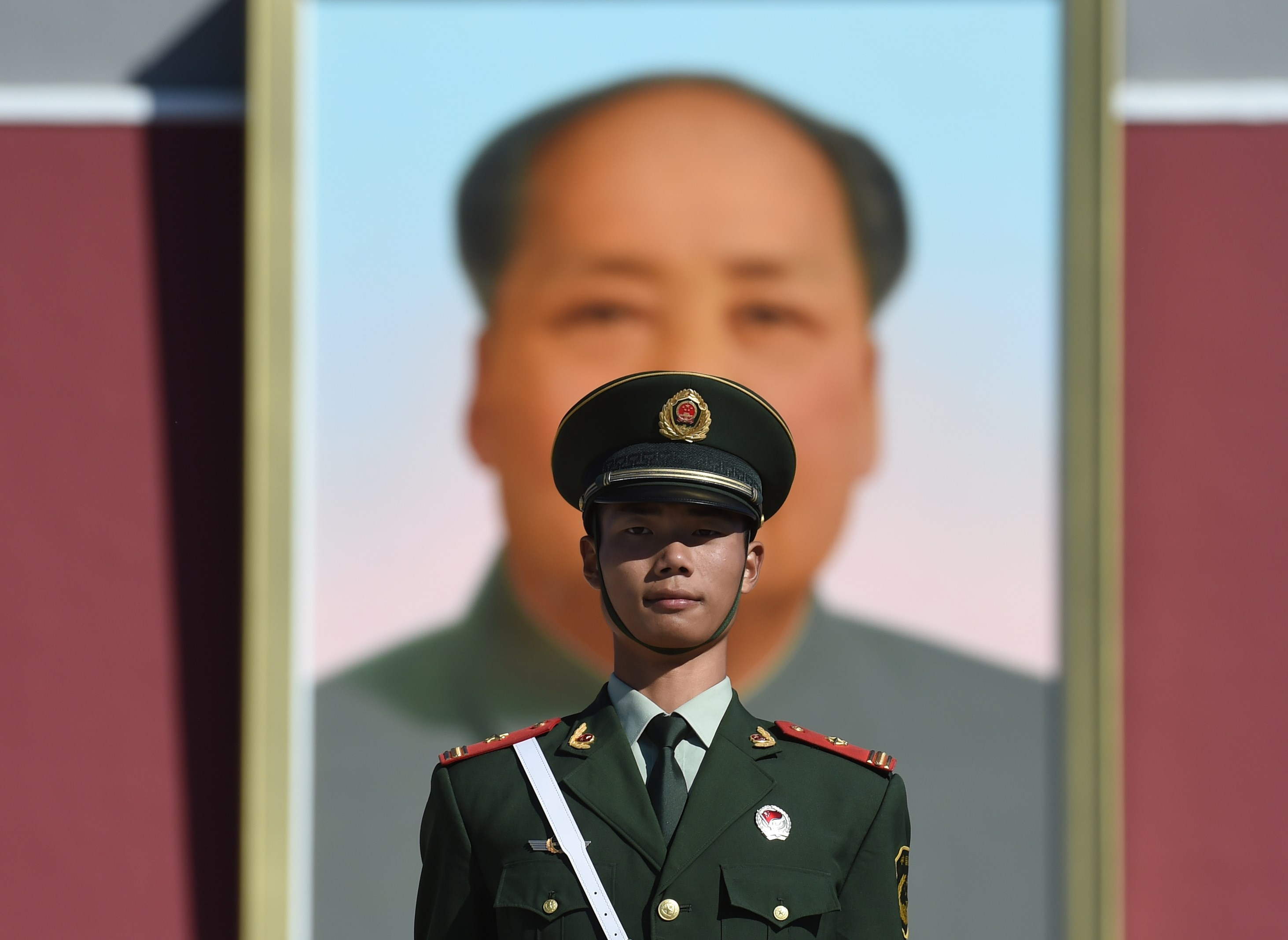A paramilitary policeman stands guard in front of the portrait of late communist leader Mao Zedong at Tiananmen Square in Beijing on Oct. 1, 2015