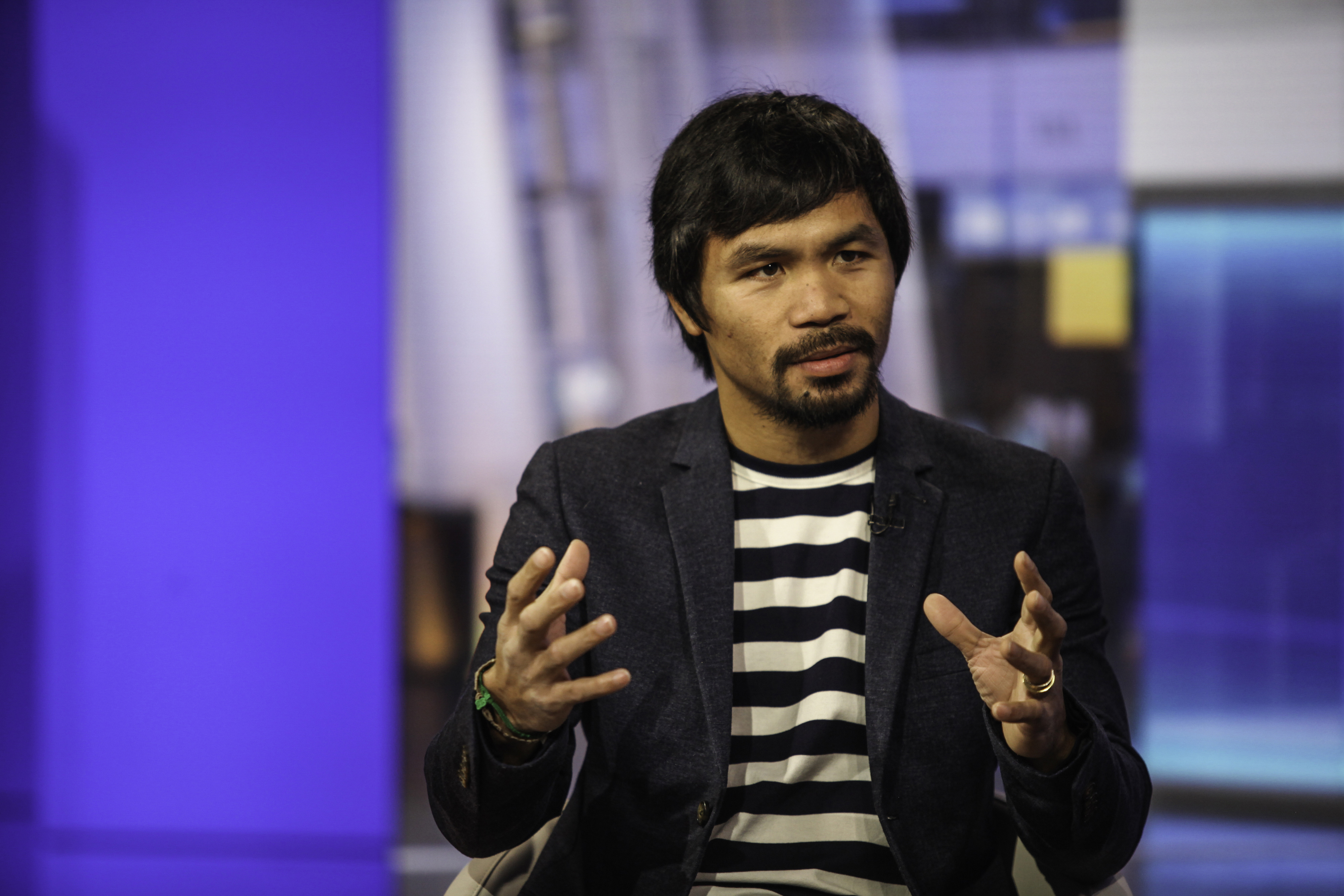 Professional boxer Manny Pacquiao speaks during a Bloomberg Television interview in New York, U.S., on Tuesday, Oct. 13, 2015.