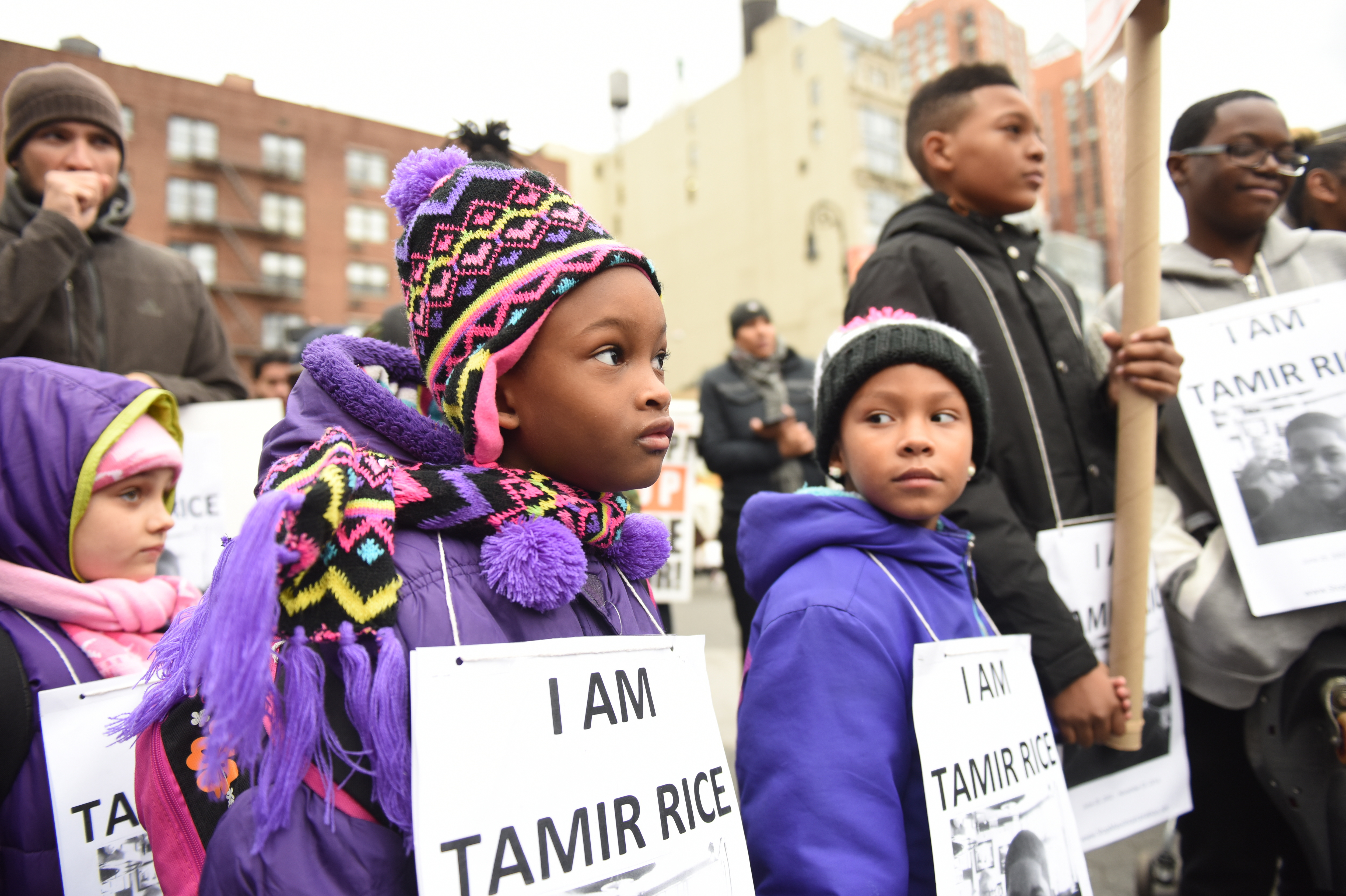 Children wear I Am Tamir Rice signs at a Stop Mass Incarcerations Network sponsored march demanding accountability on the one year anniversary of Tamir Rice's death at the hands of the Cleveland police in New York City on Nov. 22, 2015.