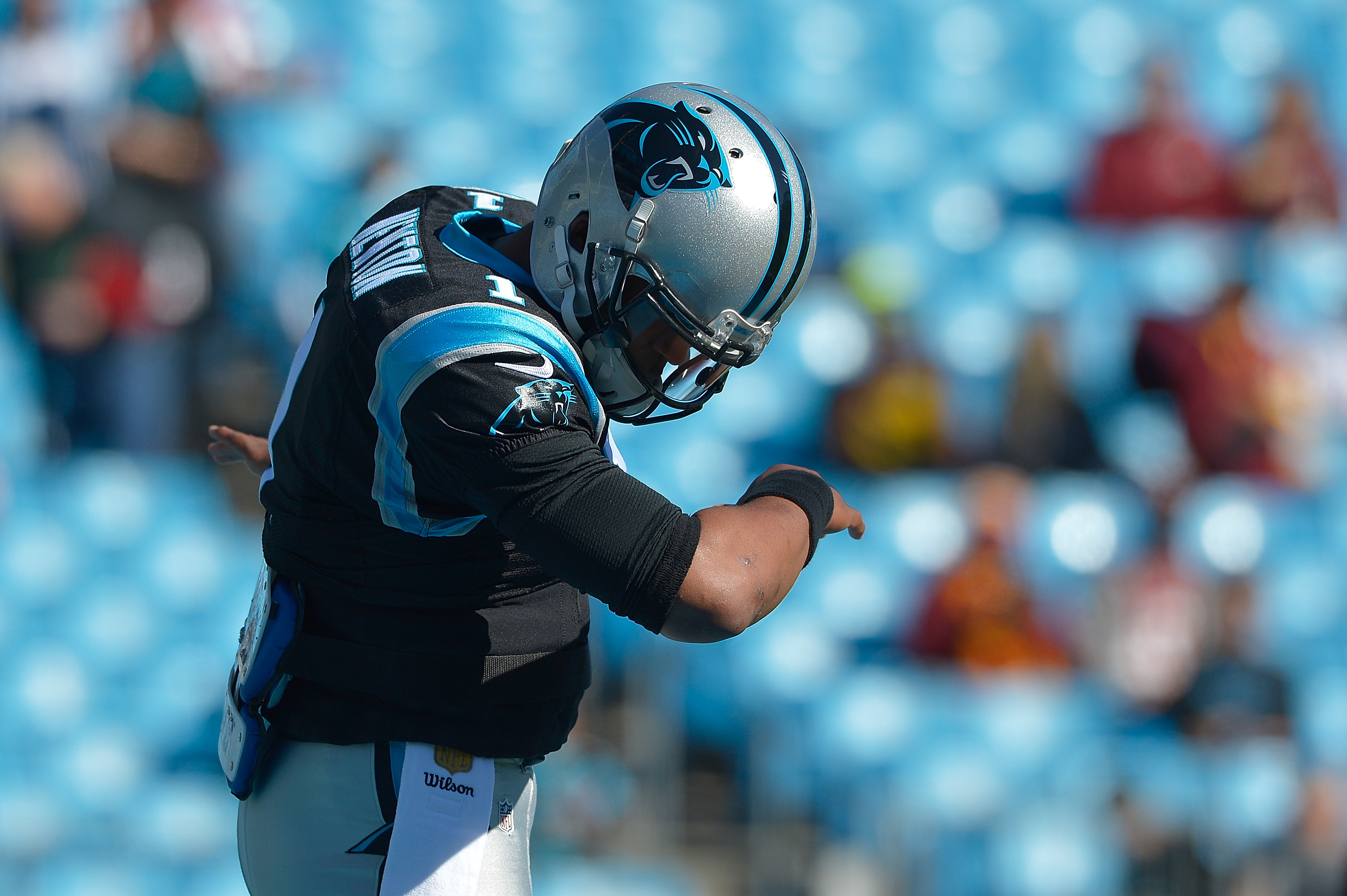 Cam Newton #1 of the Carolina Panthers dances The Dab as he warms up during their game against the Washington Redskins at Bank of America Stadium on November 22, 2015 in Charlotte, North Carolina. The Panthers won 44-16.