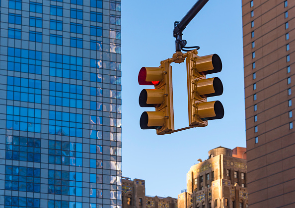 Traffic signals at work at a road intersection in Manhattan, New York city, USA.