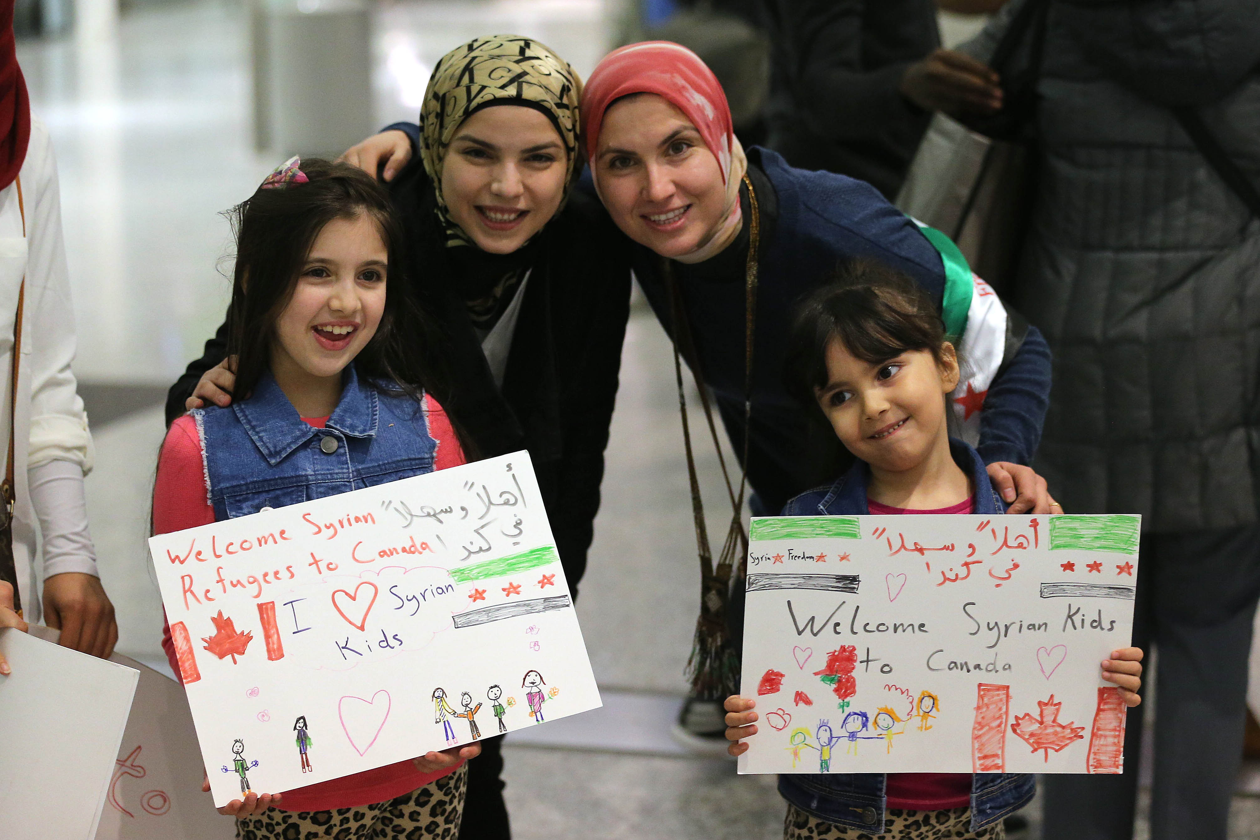 Maryam and Nore Kasmeih wait for Syrian refugees at the airport on Dec. 10, 2015. Their mother came to Canada 15 years ago and their family that was in Syria fled to Turkey.